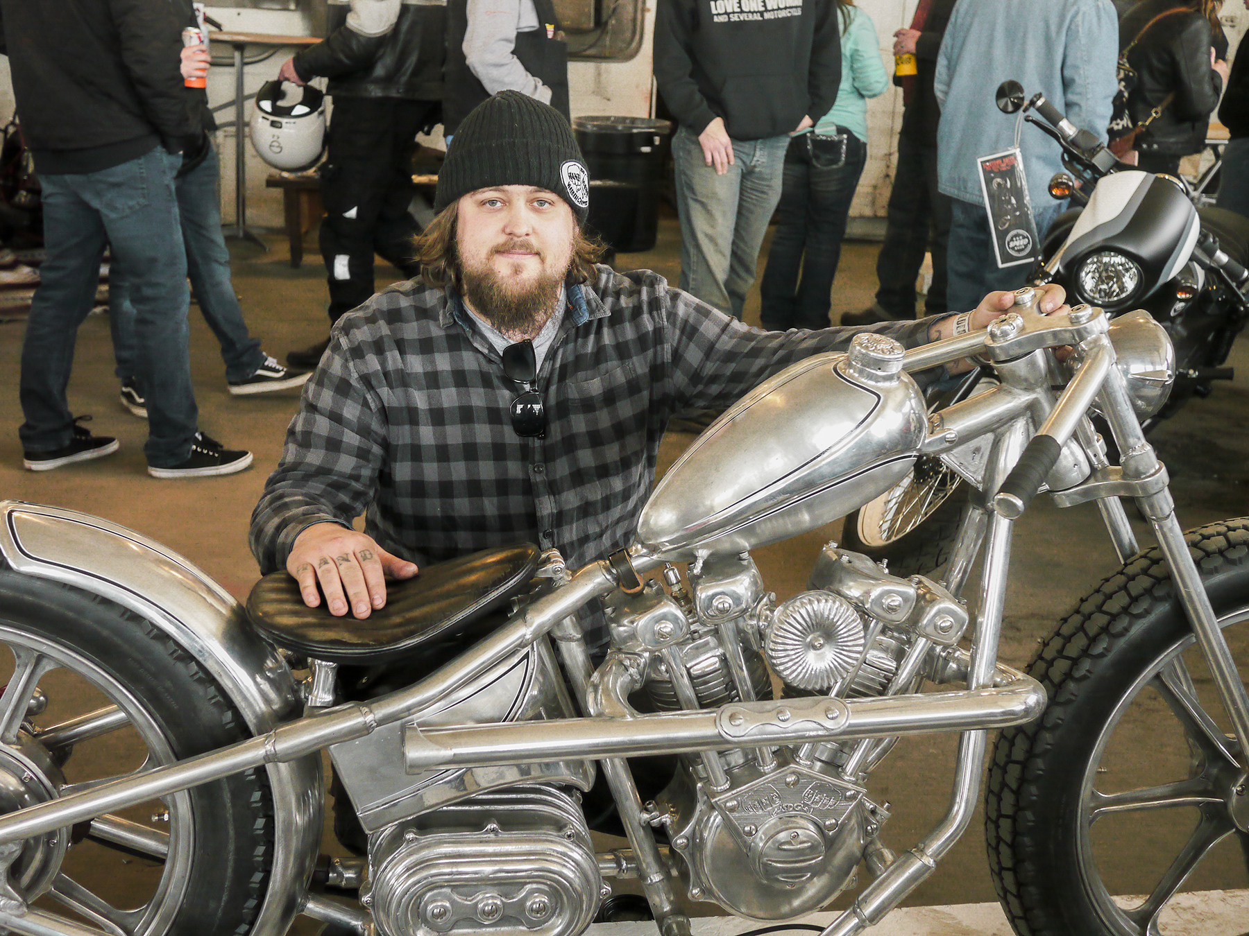 Motorcycle builder and machinist Ricky De Haas with his electric powered creation. The attention to detail in the castings is amazing.