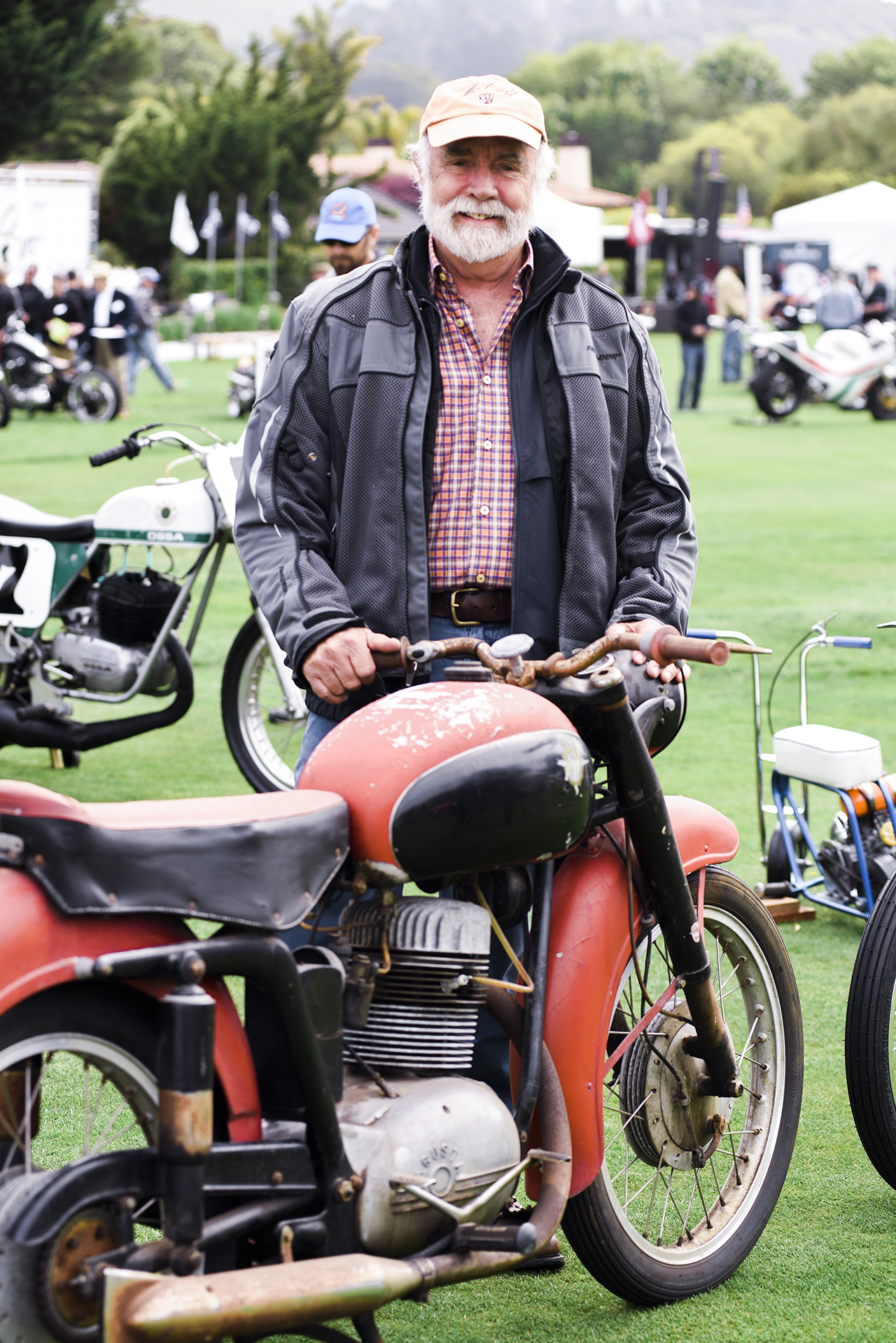 "Rob Talbott with his unrestored 1955 MV 175 CSTL. ""It is important to me to see where they start,"" said Talbott. ""And it will never be touched."" The bike was parked next to a fully restored version of the same bike. As is often the case the unrestored version garnered much more attention."