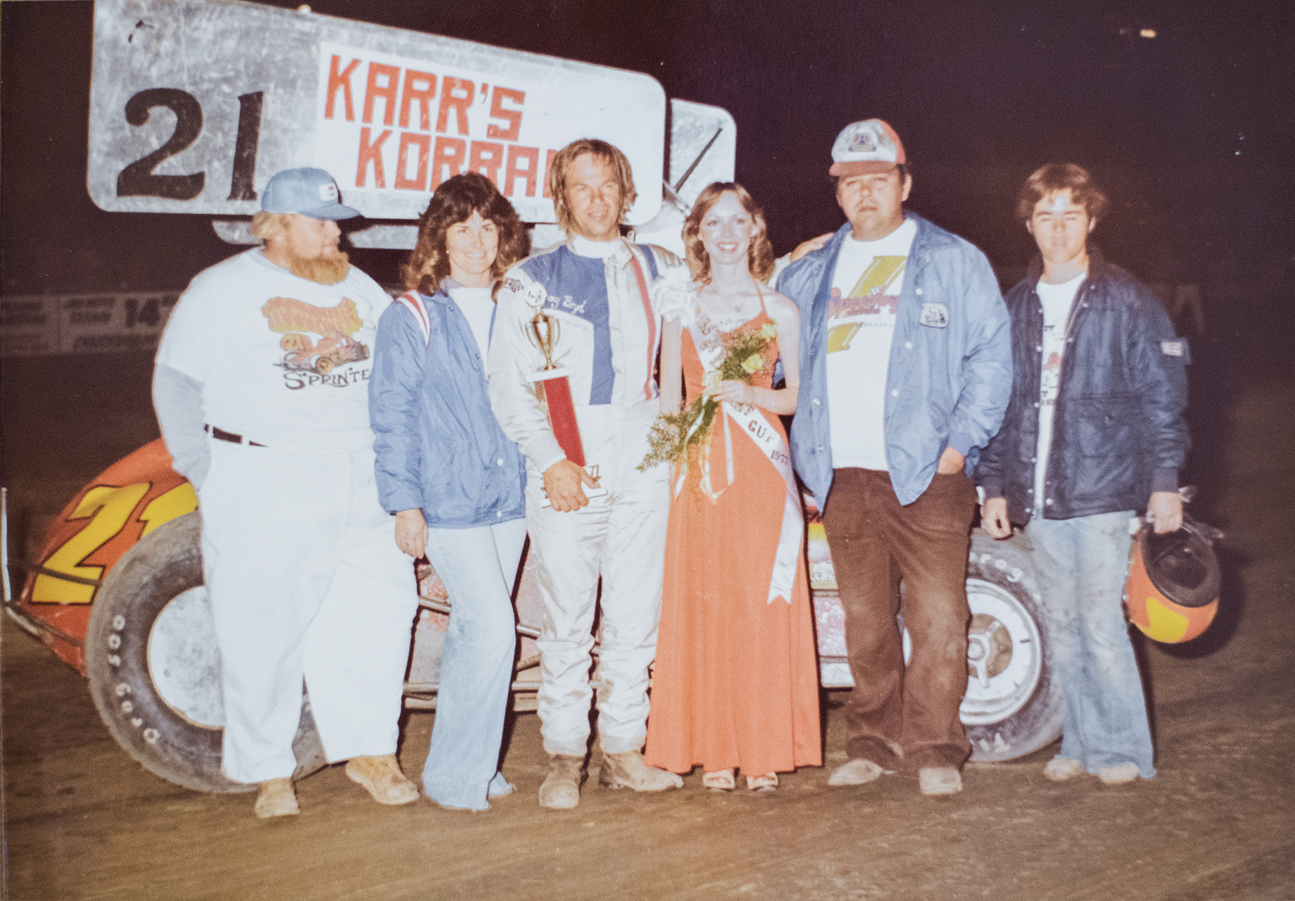 "1977 Dirt Cup champs (left to right): ""Tiny, "" Betty Boyd, Jimmy Boyd, trophy queen, Kenny Woodruff and ""Little Richard"" Brown at Skagit Speedway in Washington. (Boyd family archive)"
