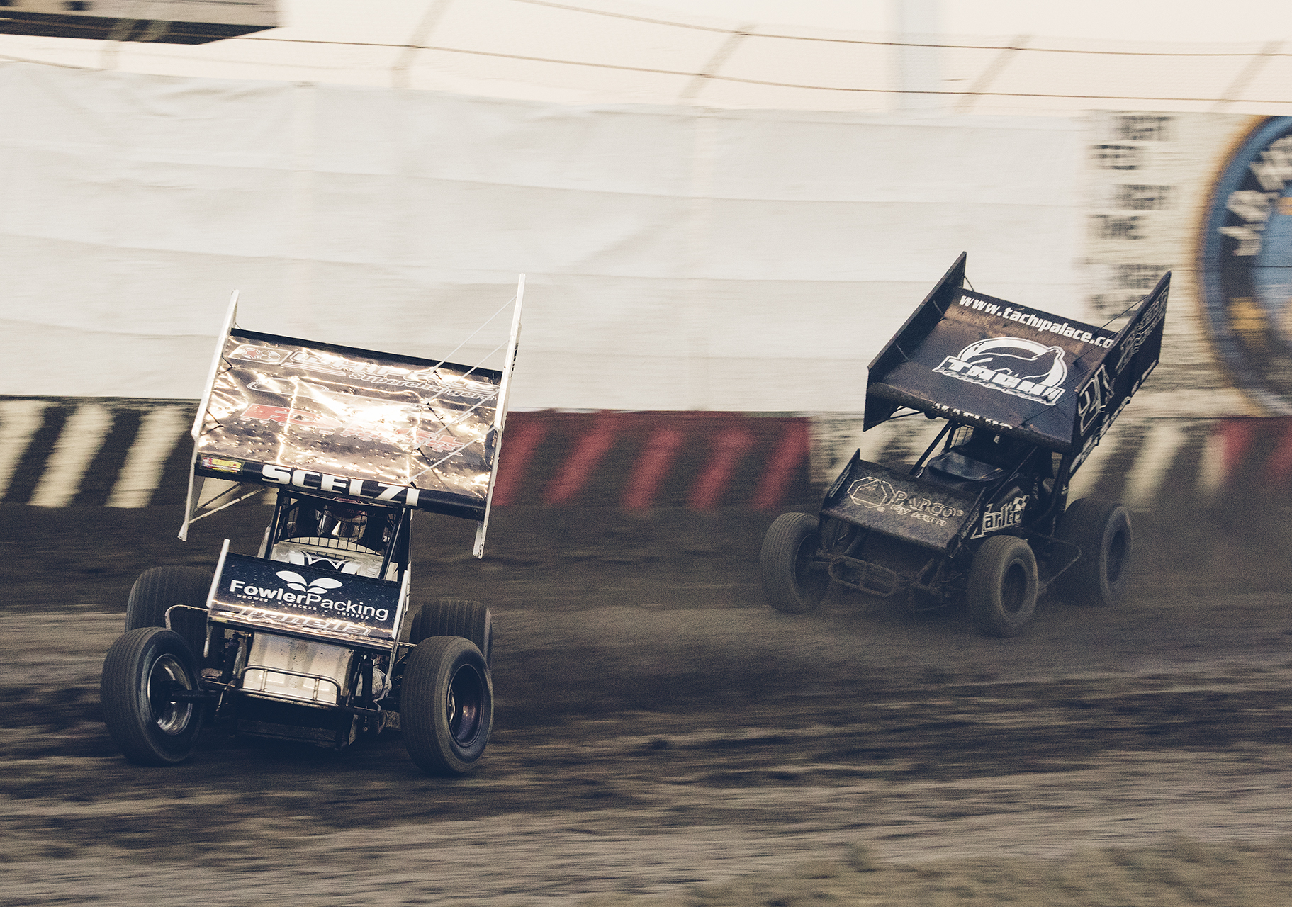 Dominic Scelzi leads Carson Macedo into turn three at Thunderbowl Raceway during a King of the West Series heat race, 2015.