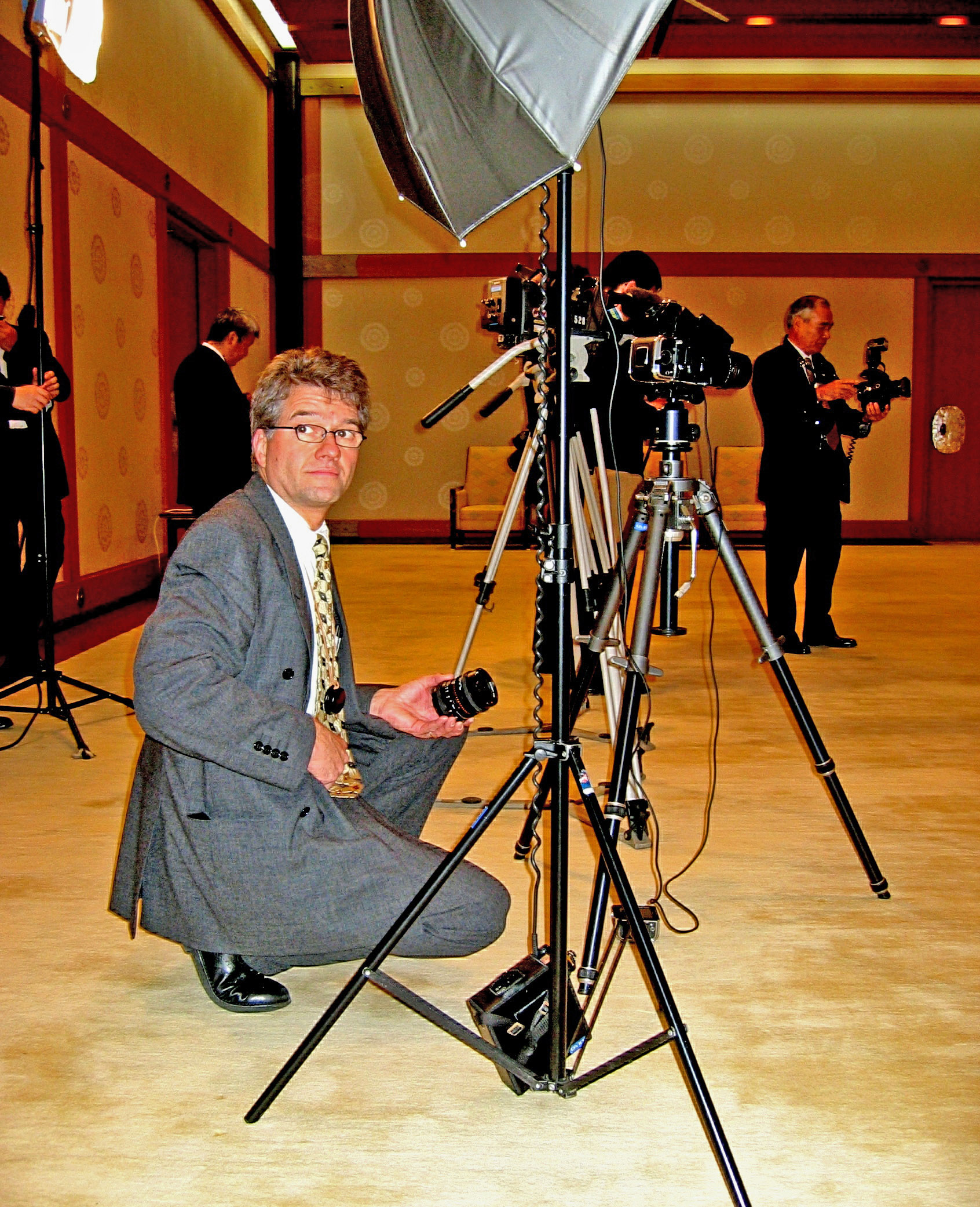 """Beat Pfändler getting his equipment set up to photograph the Japanese Empress for his book """"Swiss Guest Book""""."""