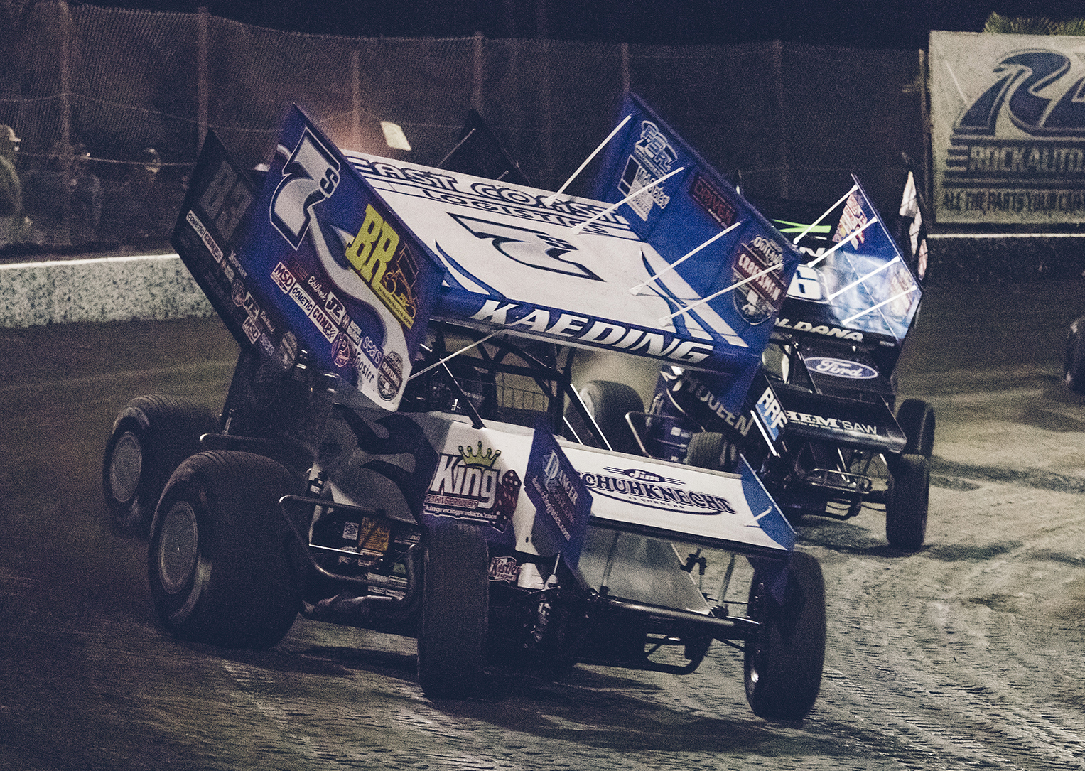 Driving for Sides Motorsports, Tim leads a pack of Outlaws during a heat race at Bakersfield, 2018.