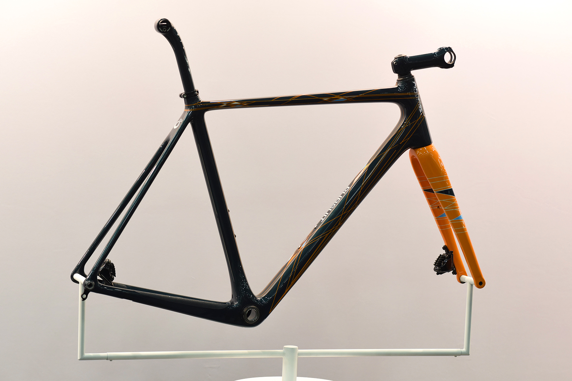 This carbon fiber frame was made by Pursuit Bicycles in Bozeman Montana. Owned by husband and wife team Carl and Loretta Strong, they build about 35 frames to one design a year. Everything is made in house including the molds.