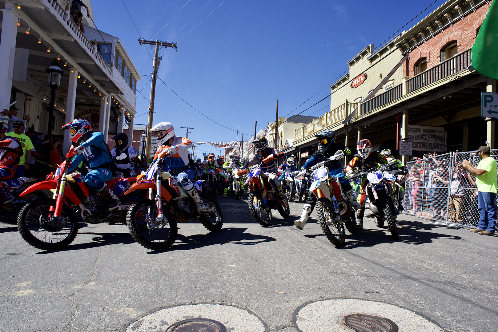 The front row heads out at the green flag. All the riders line up along C street which brings the excitement and drama of the start to the heart of Virginia City.