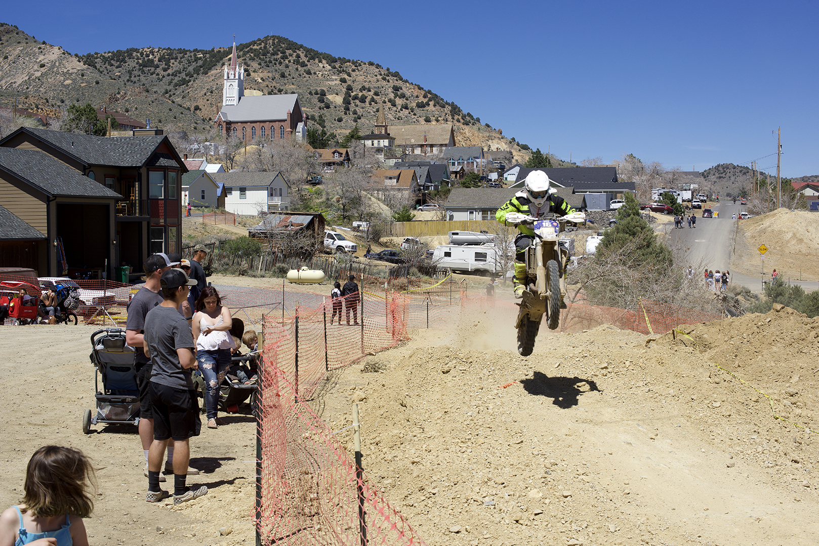 The course comes in to town in a couple places and spectators can get as close a look at the racing as they want to. Willy Heiss gets it going past the pits.