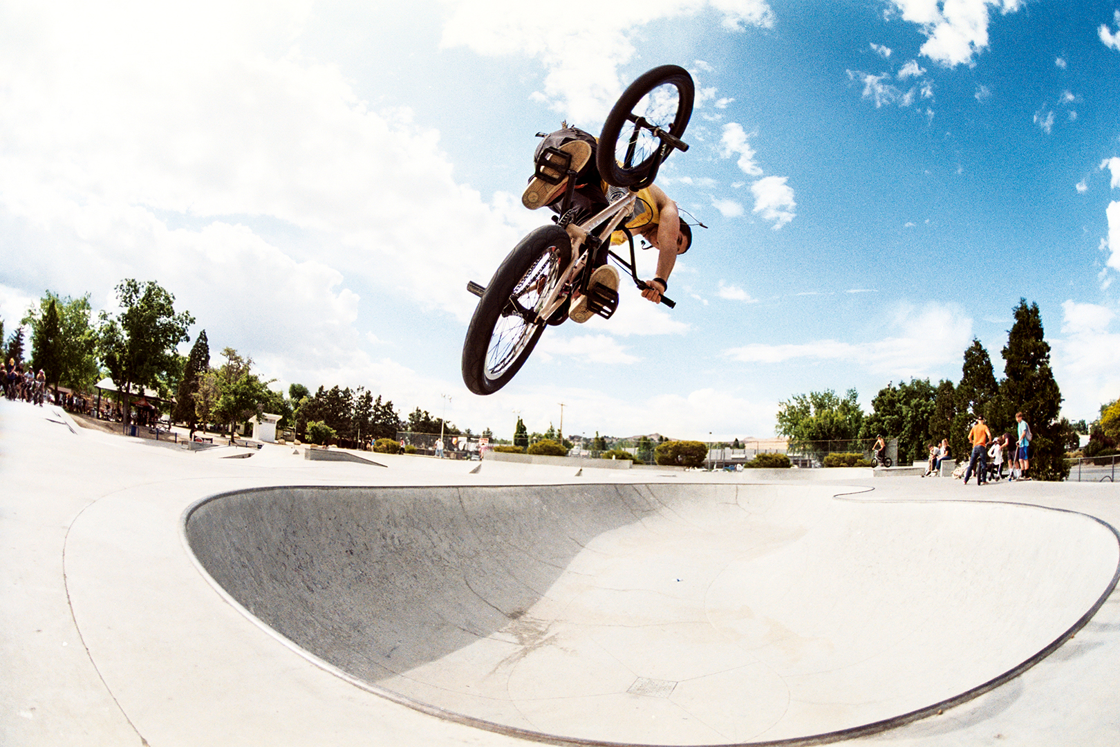 """This is a local kid named Chad Curtis. We all went up to Reno for a BMX jam and Chad has been working on his """"turndowns"""" so I told him to snap one in the deep end of this bowl. This was with the Nikon FM2 and the 16mm Nikkor."""