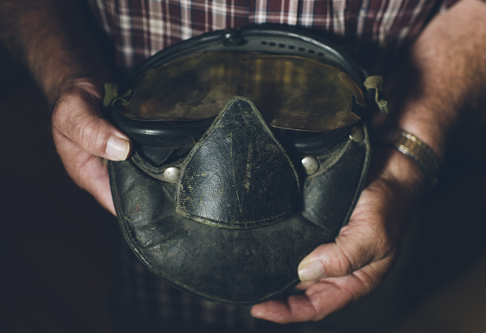 Long before full-face helmets: Johnny holds his leather face mask. It was common for drivers to wear one for protection from flying debris.