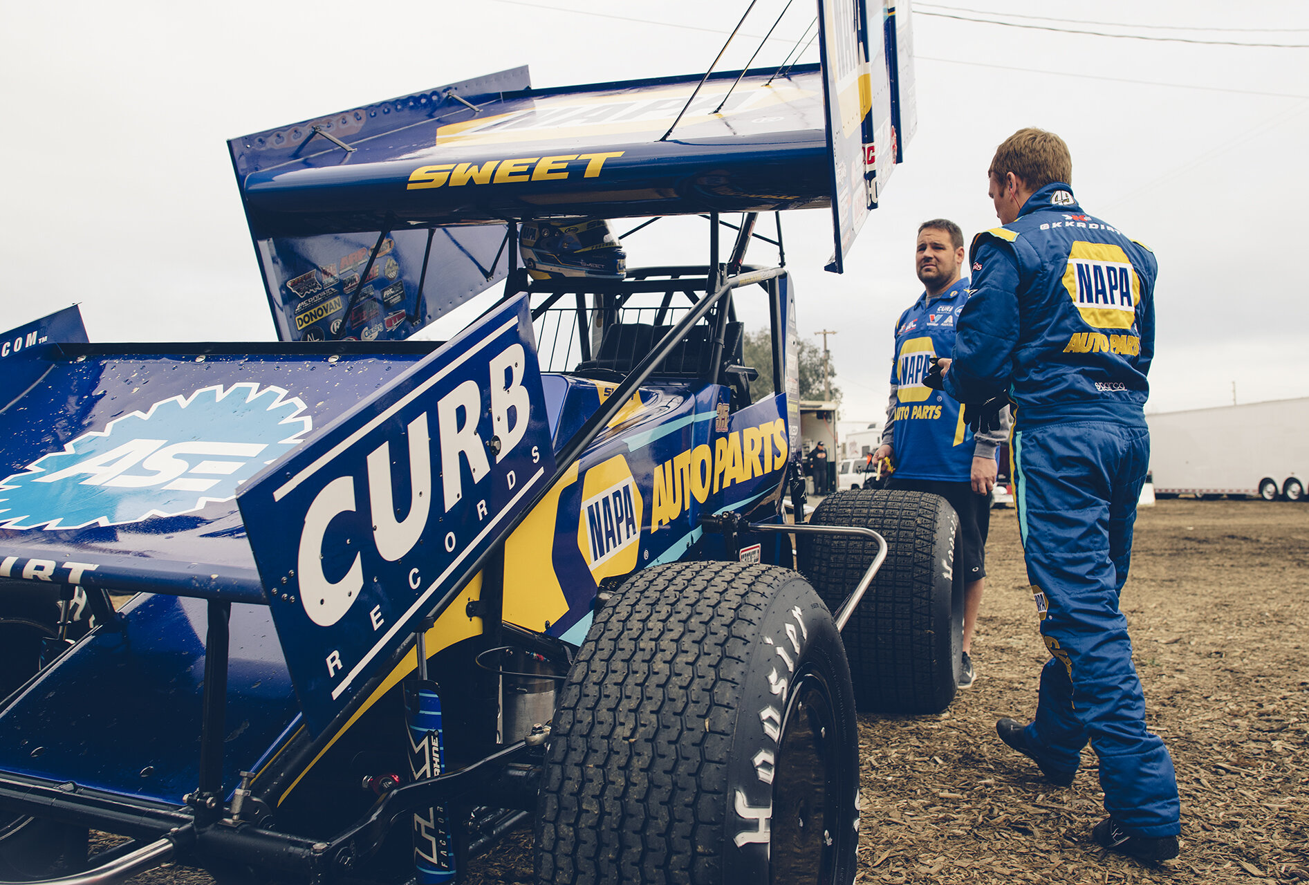 Ready for work: Sweet in the pits with crew chief Eric Prutzman at Thunderbowl Raceway in Tulare, Calif., March 2019.
