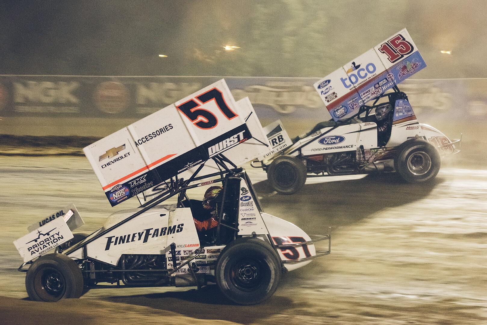 Main event action: Larson battles for position with Donny Schatz.