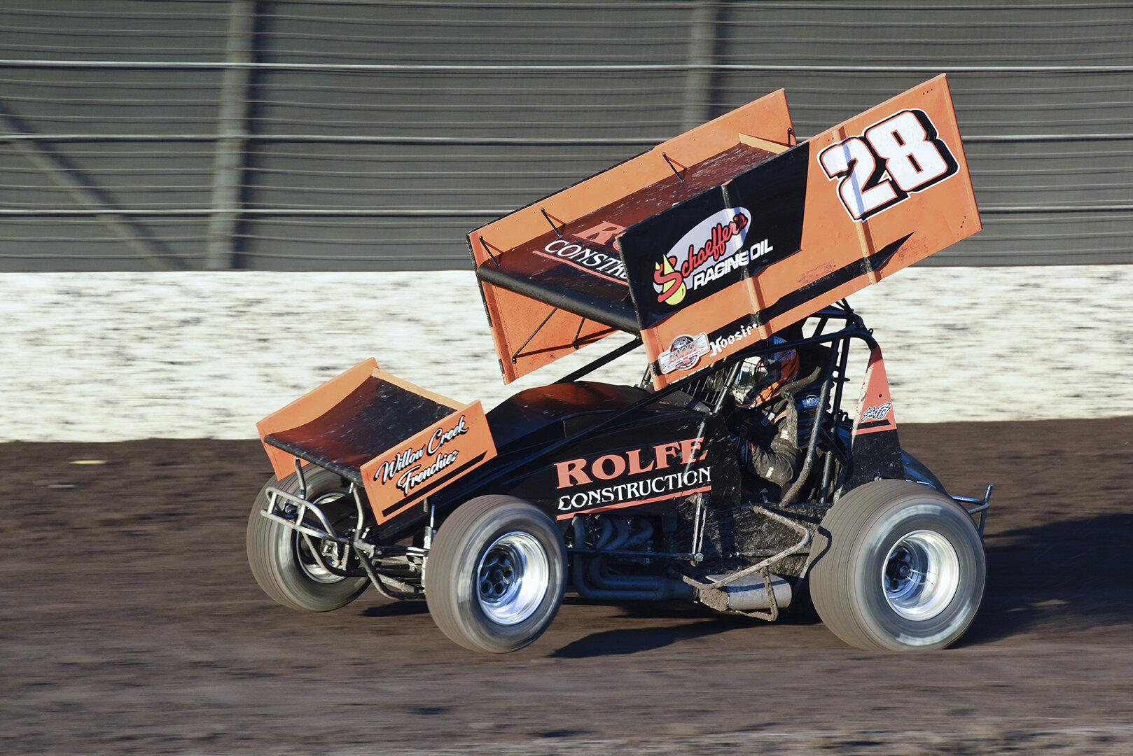 Nathan Rolfe pulling a wheelie down the back stretch in his heat race. Rolfe finished 13th in the feature. These cars make over 800 horse power. They are very light with a short wheel base giving them explosive acceleration.