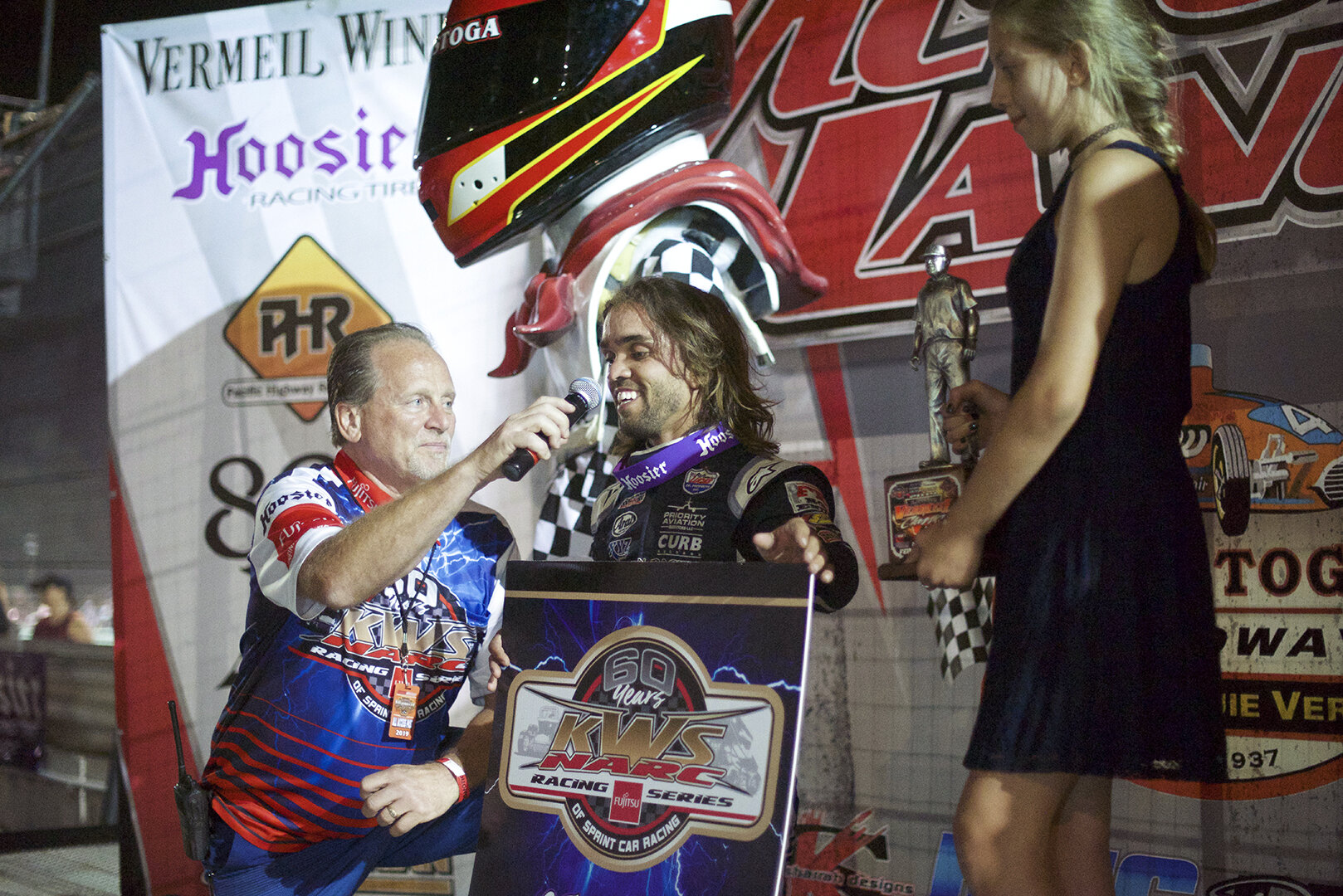 Rico Abreu celebrating his 11th win at Calistoga. The trophy girl (Leroy Van Conett's great grand daughter Kailey) holds the coveted Louis statue.