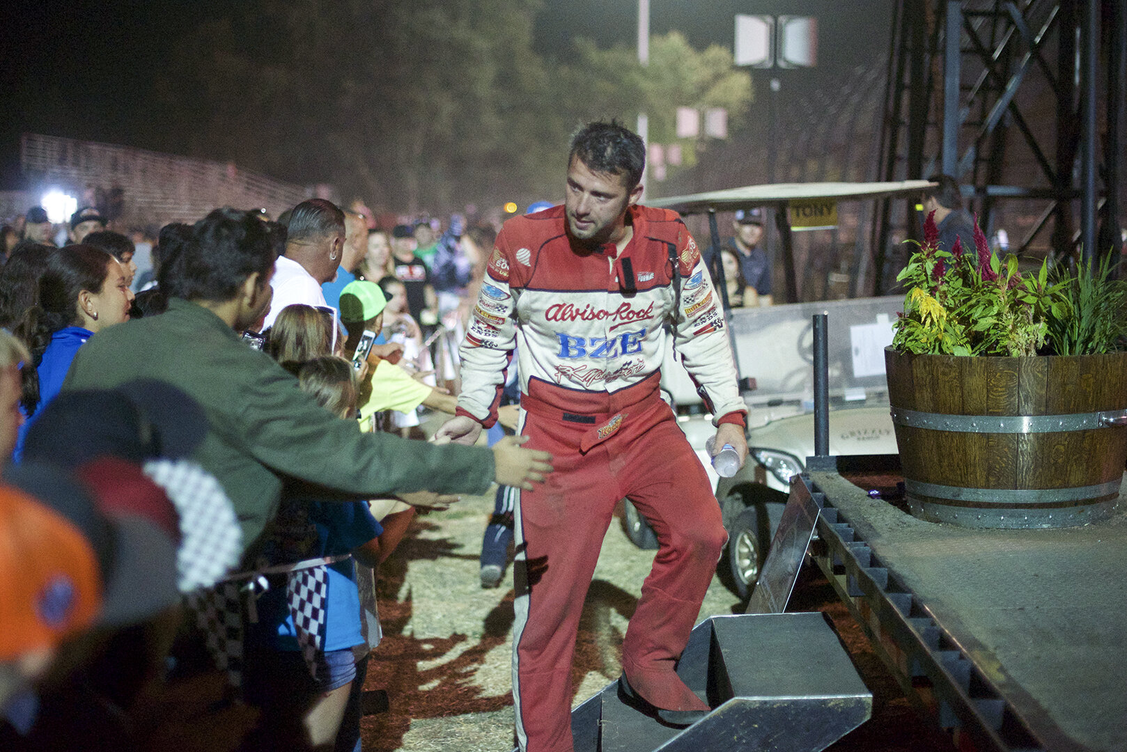 Bud Kaeding thanks the fans as he mounts the podium to celebrate a well earned second place finish in the wing car race.