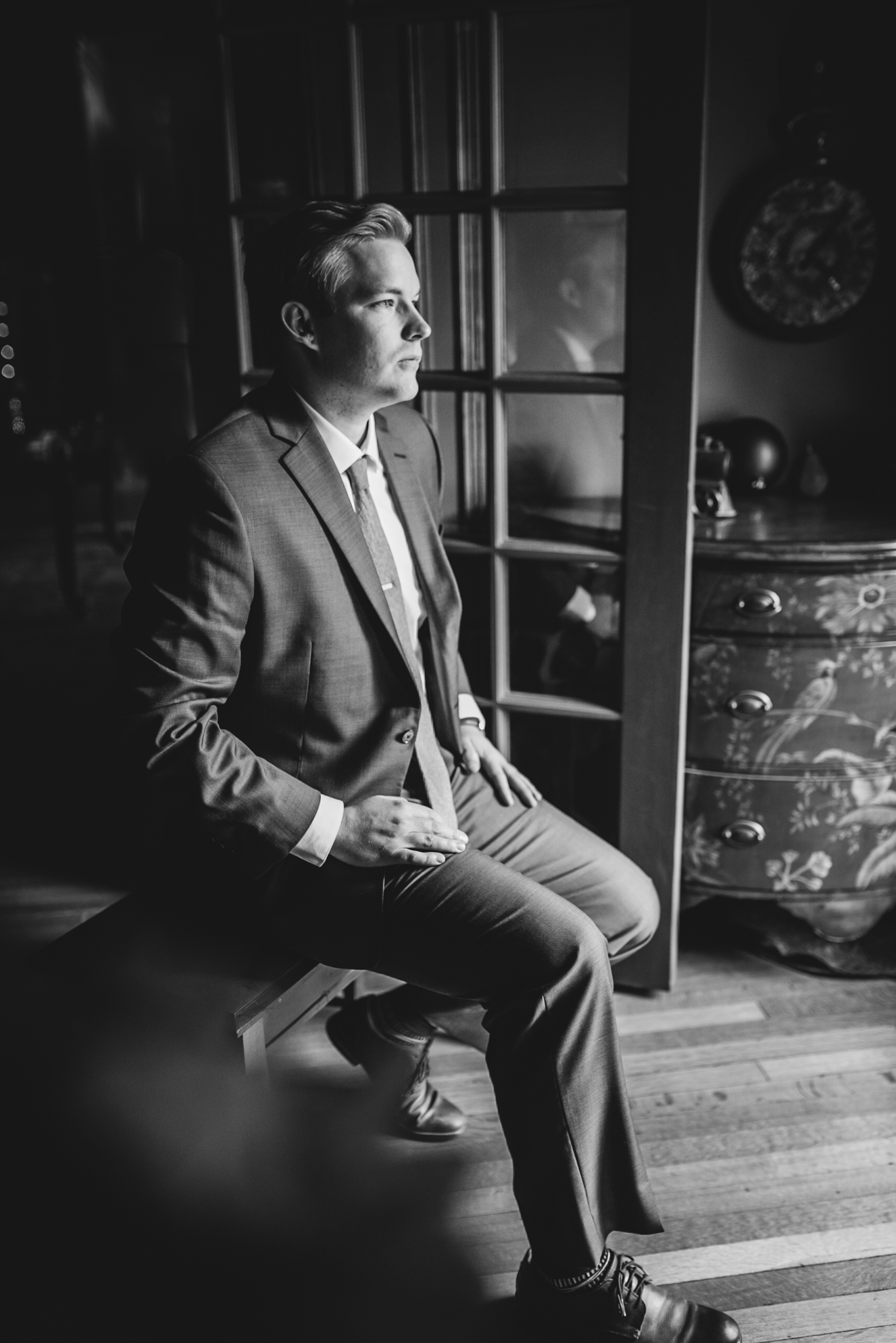 Groom Candid Shot sitting in Ft. Worth Victorian Mansion