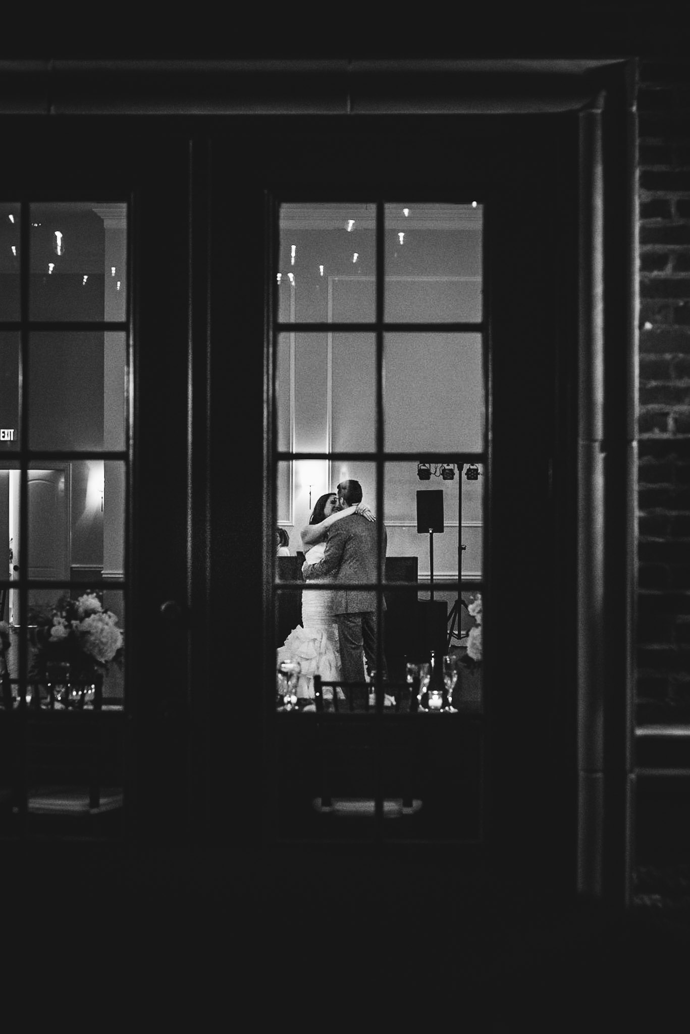 Bride and groom dancing alone after wedding is over