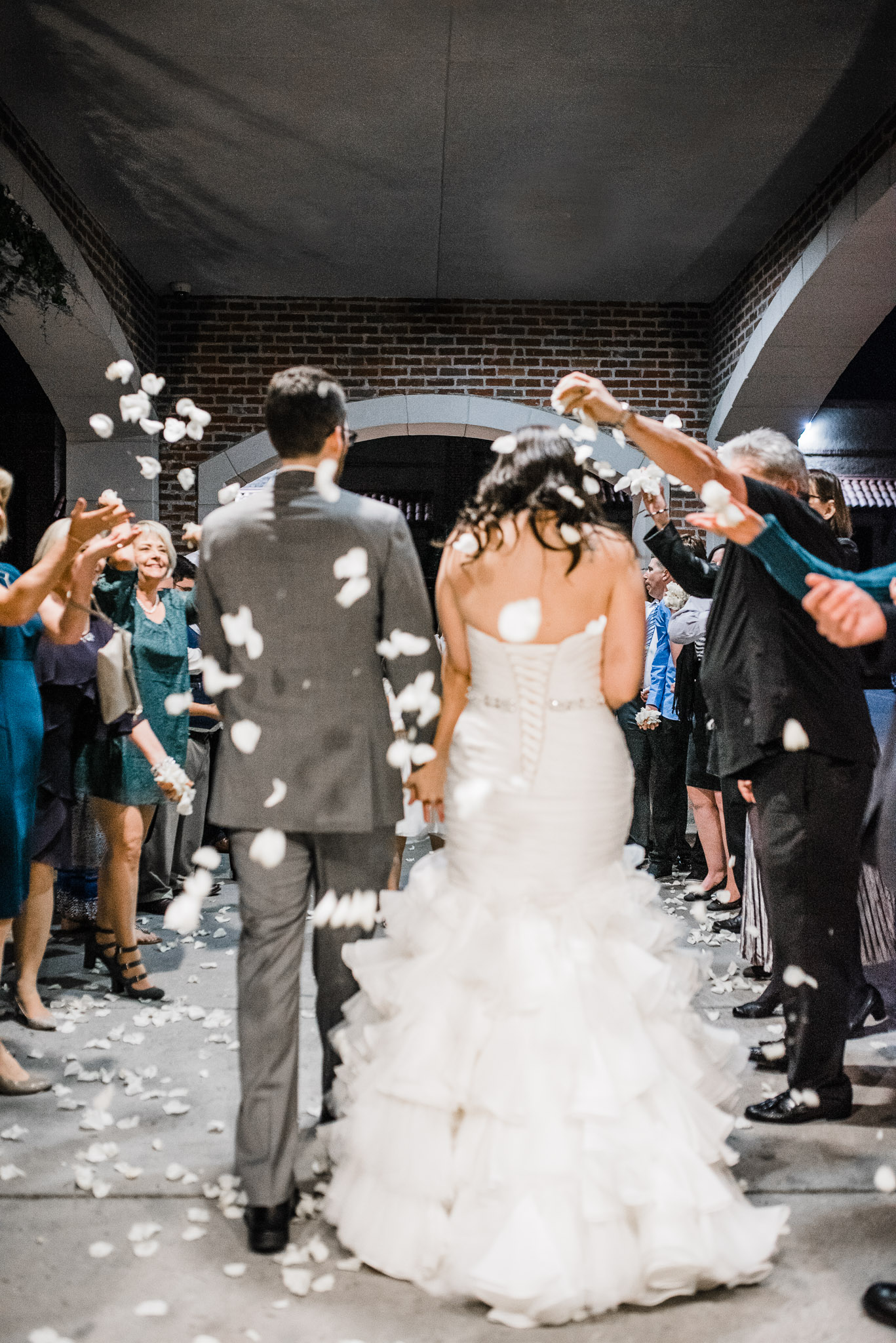 Bride and groom send off with white rose pedals