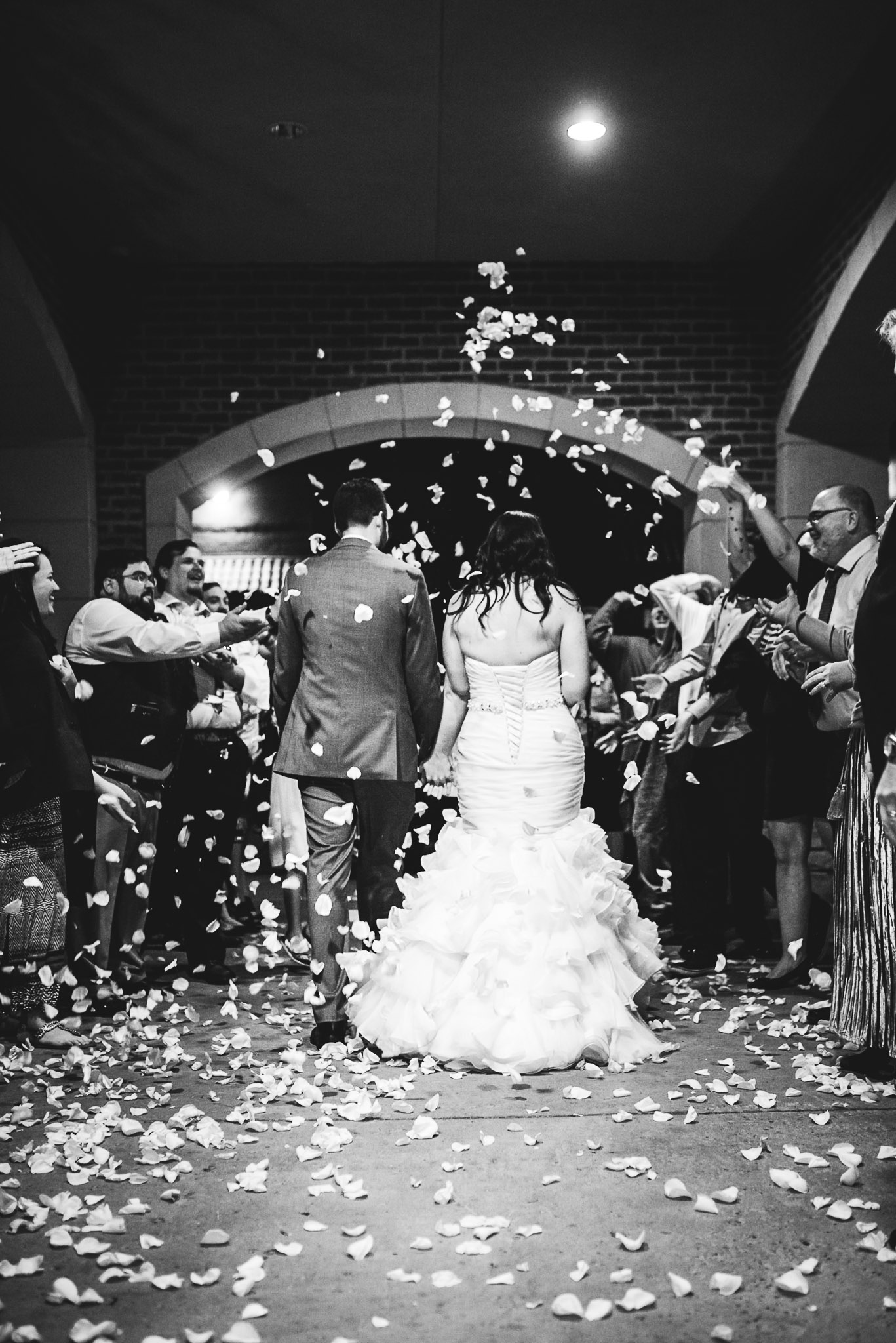 Family send off the new couple and shower them with white rose pedals