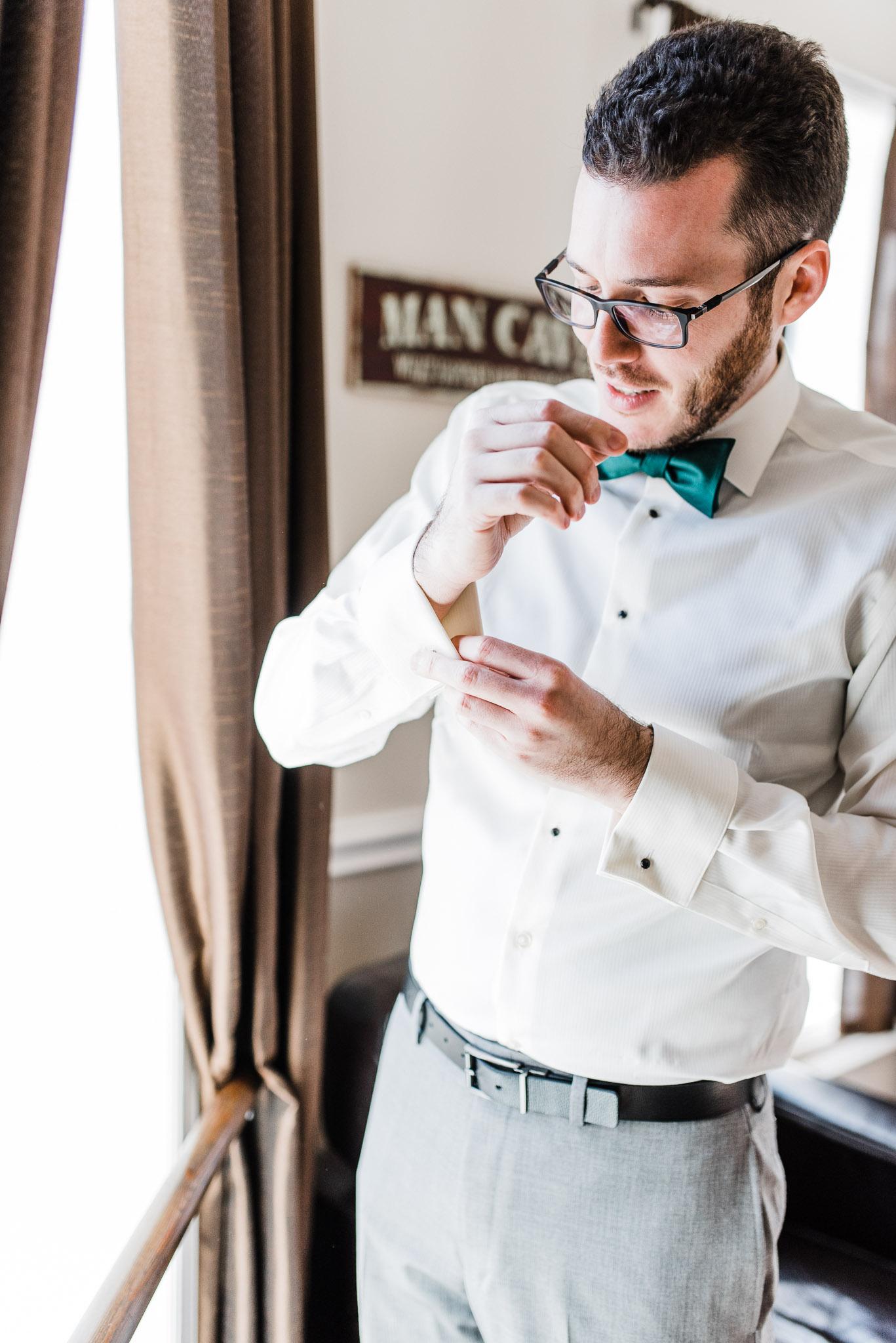 Groom getting ready in groom suite at Windsor Park