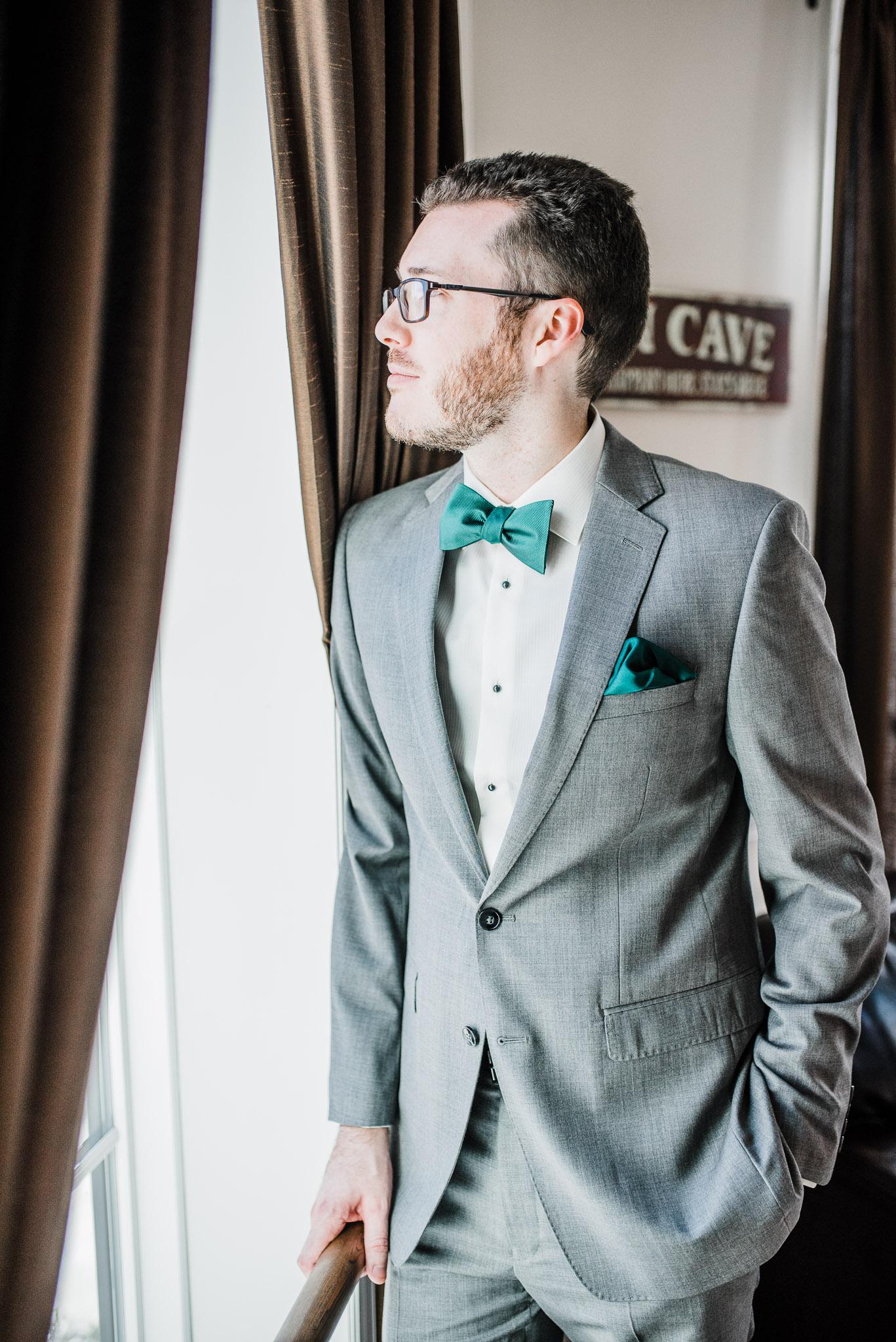 Groom wearing emerald bowtie