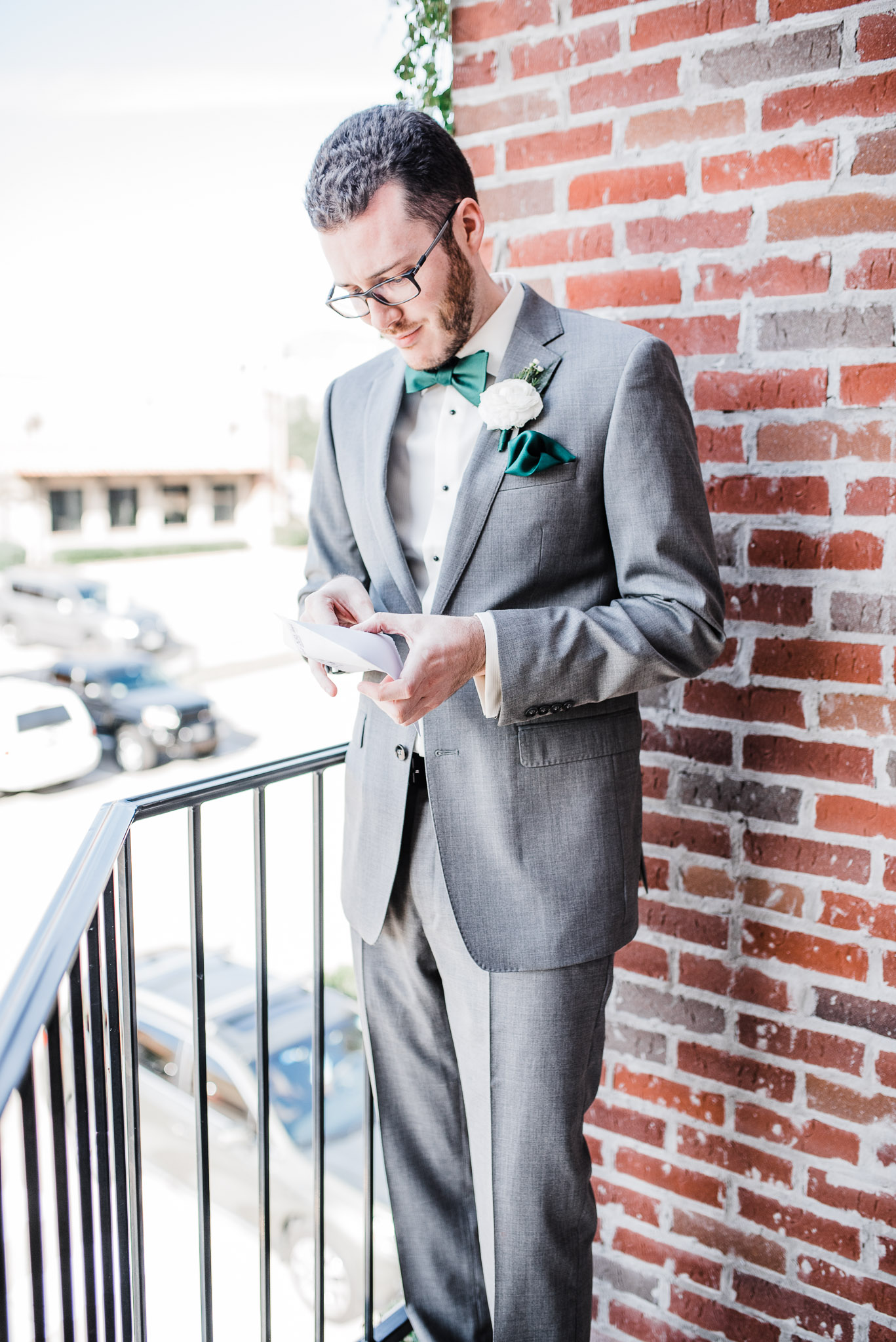 Groom reading a letter from his bride