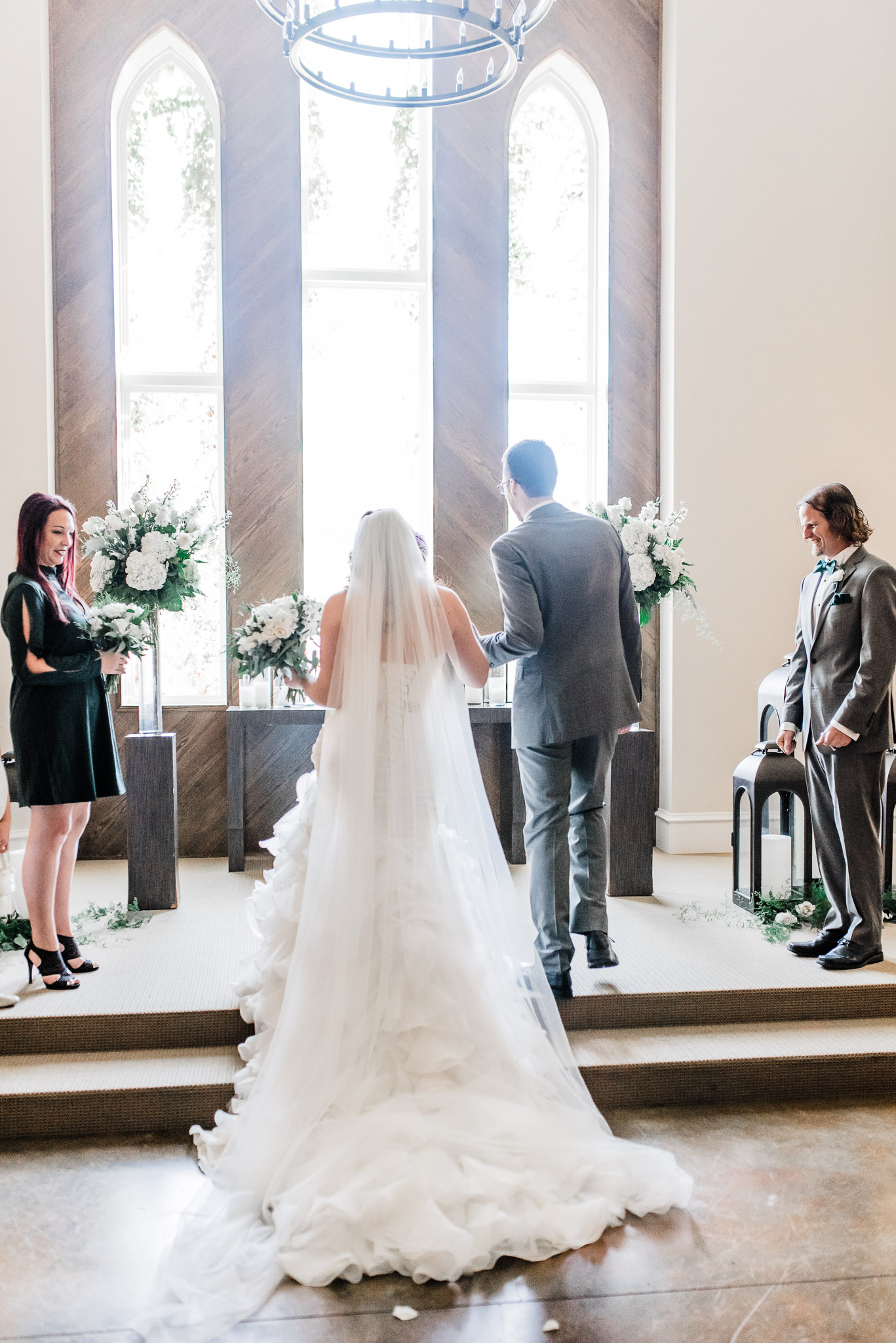 Groom takes his bride to the altar