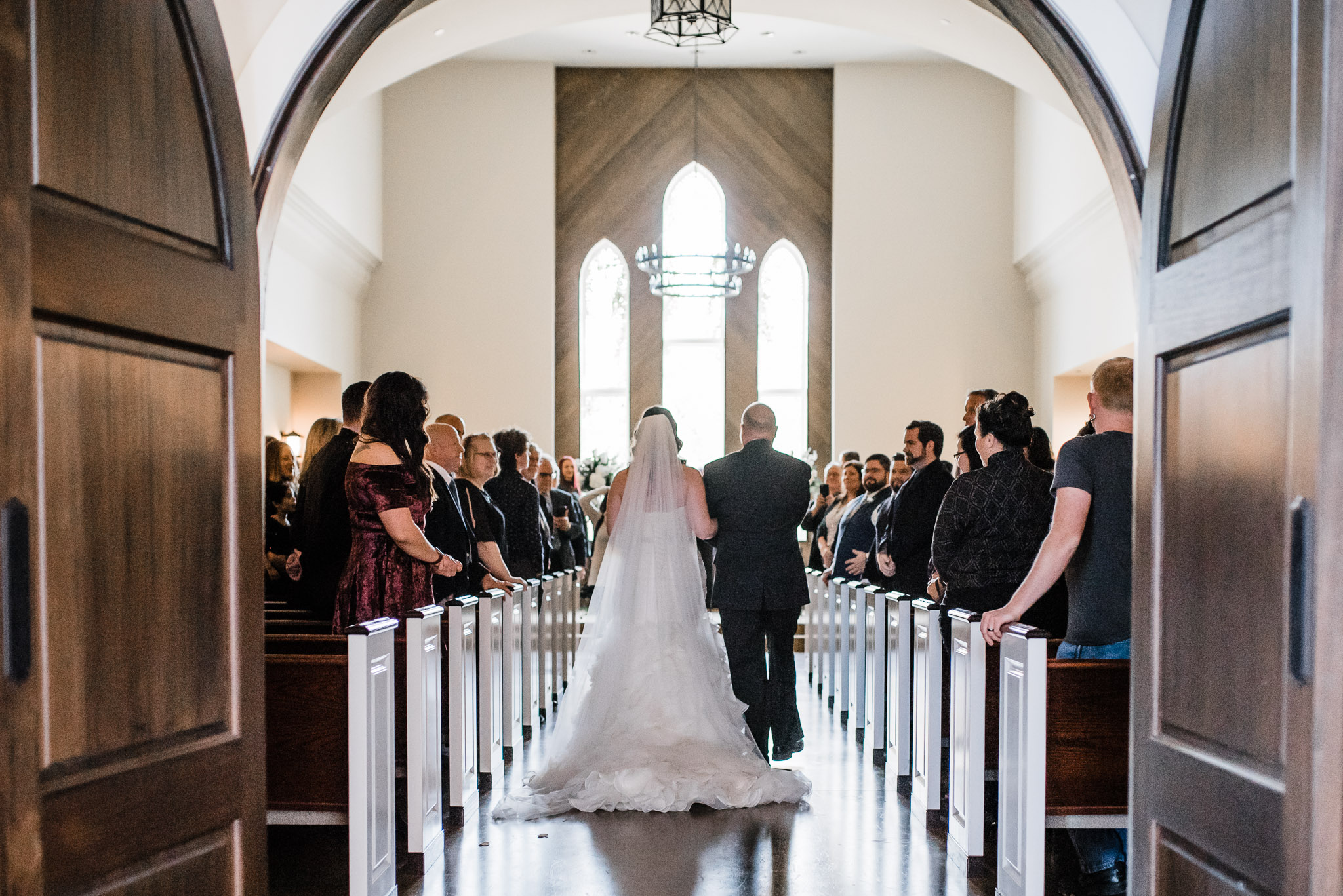 Father and Bride walk down the Isle of The Widsor Church