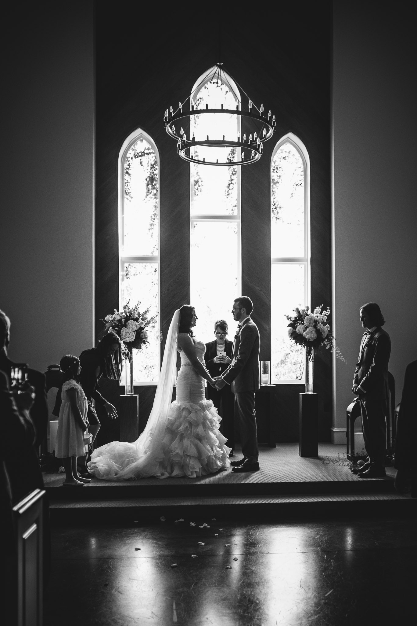 bride and groom reading their vows