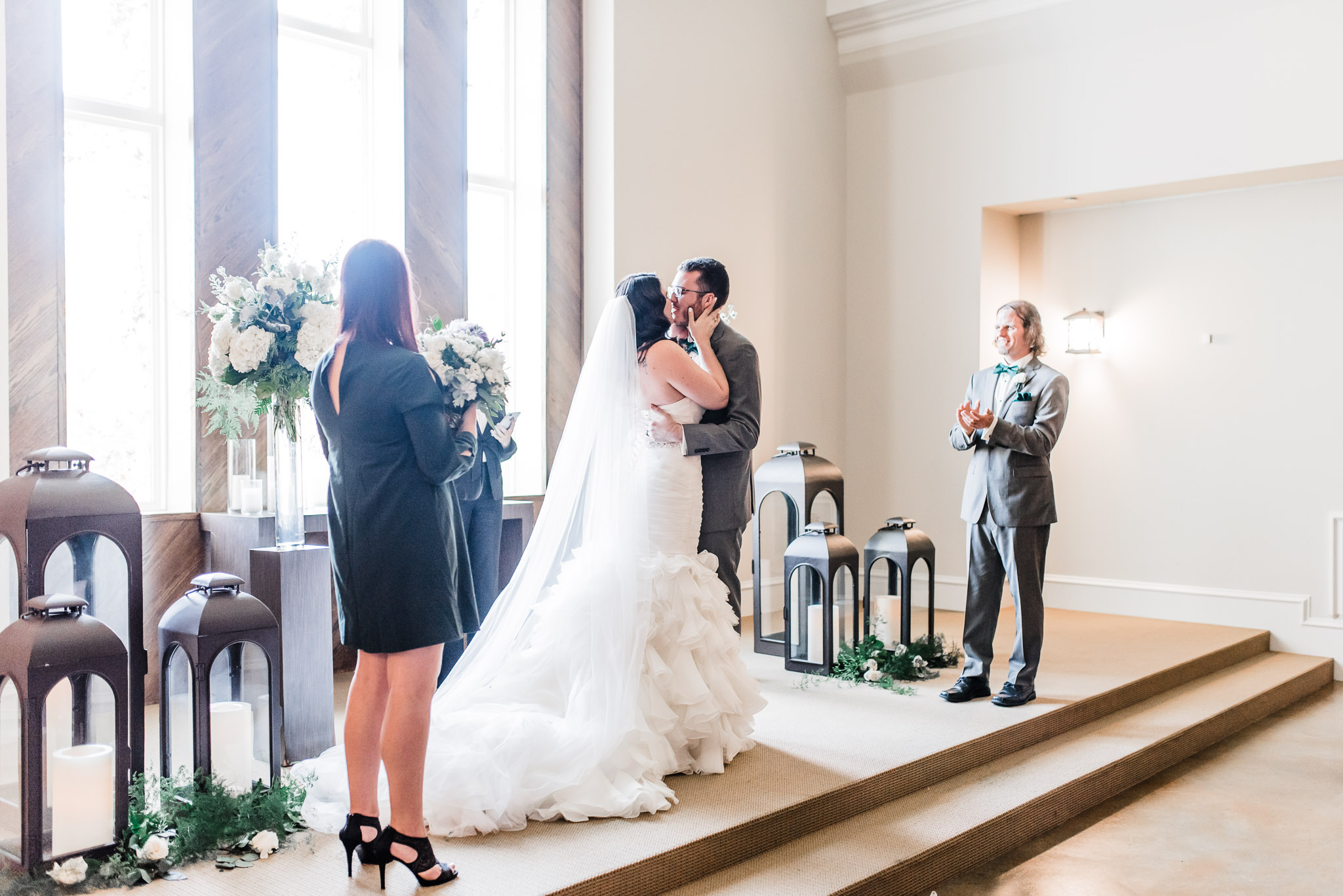 Bride and groom come in for their first kiss