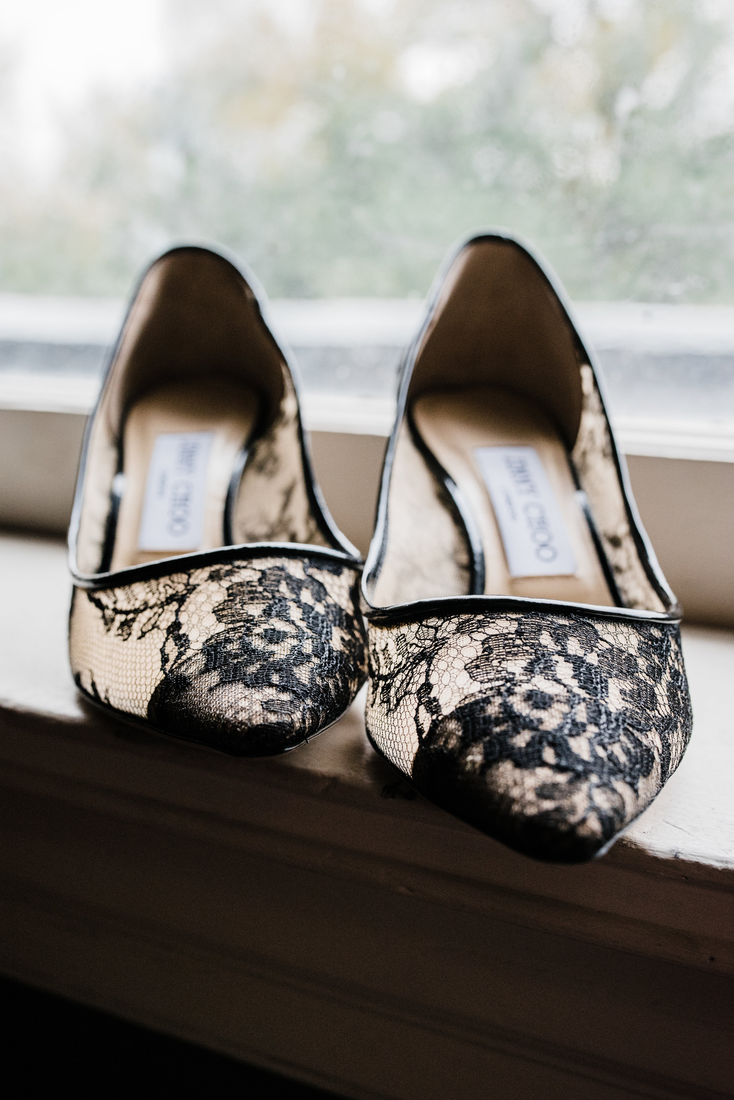 Jimmy Choo Brides Heels sitting on window in home in Highland Park Texas
