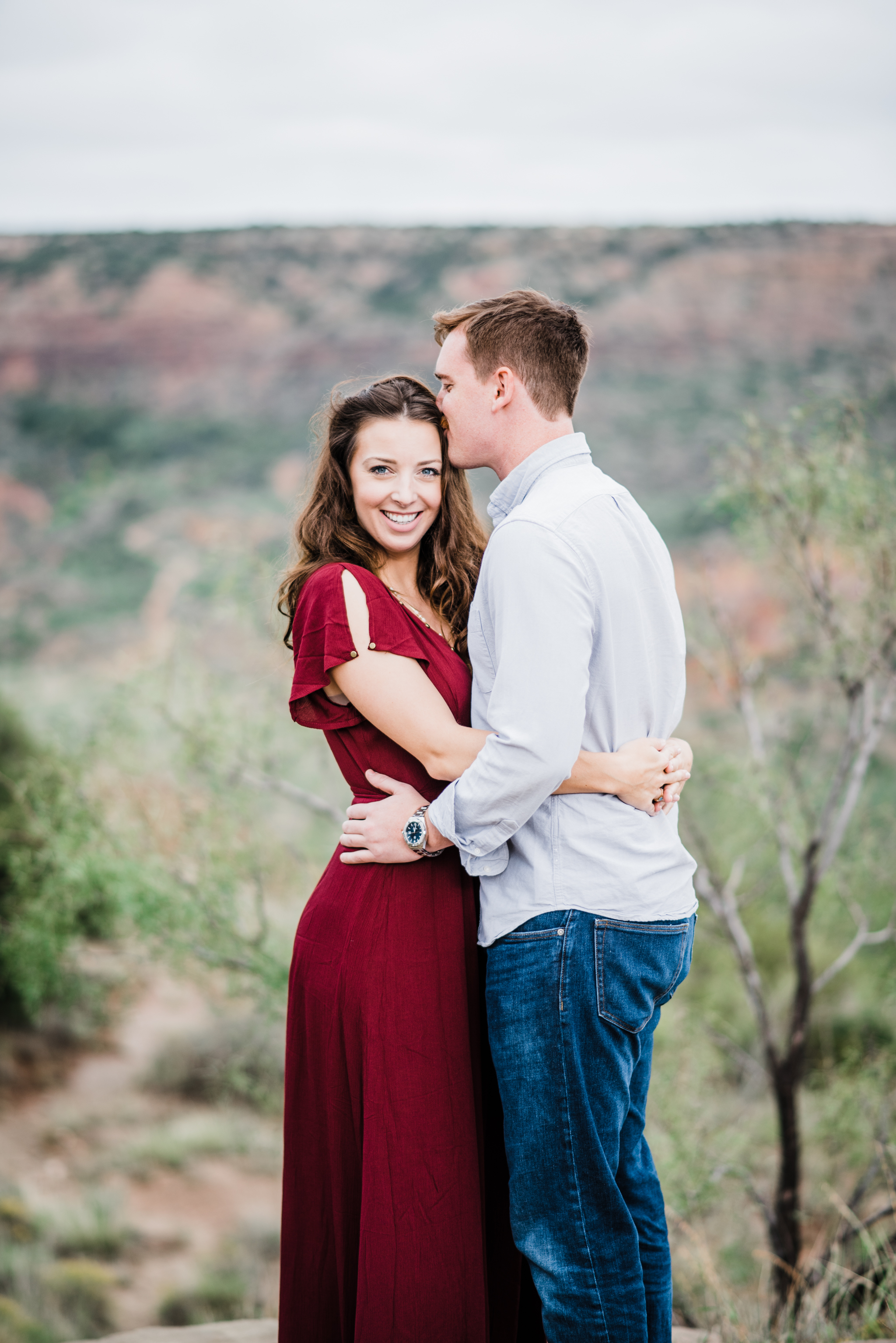 Engaged couple posing in Palo Duro State Park