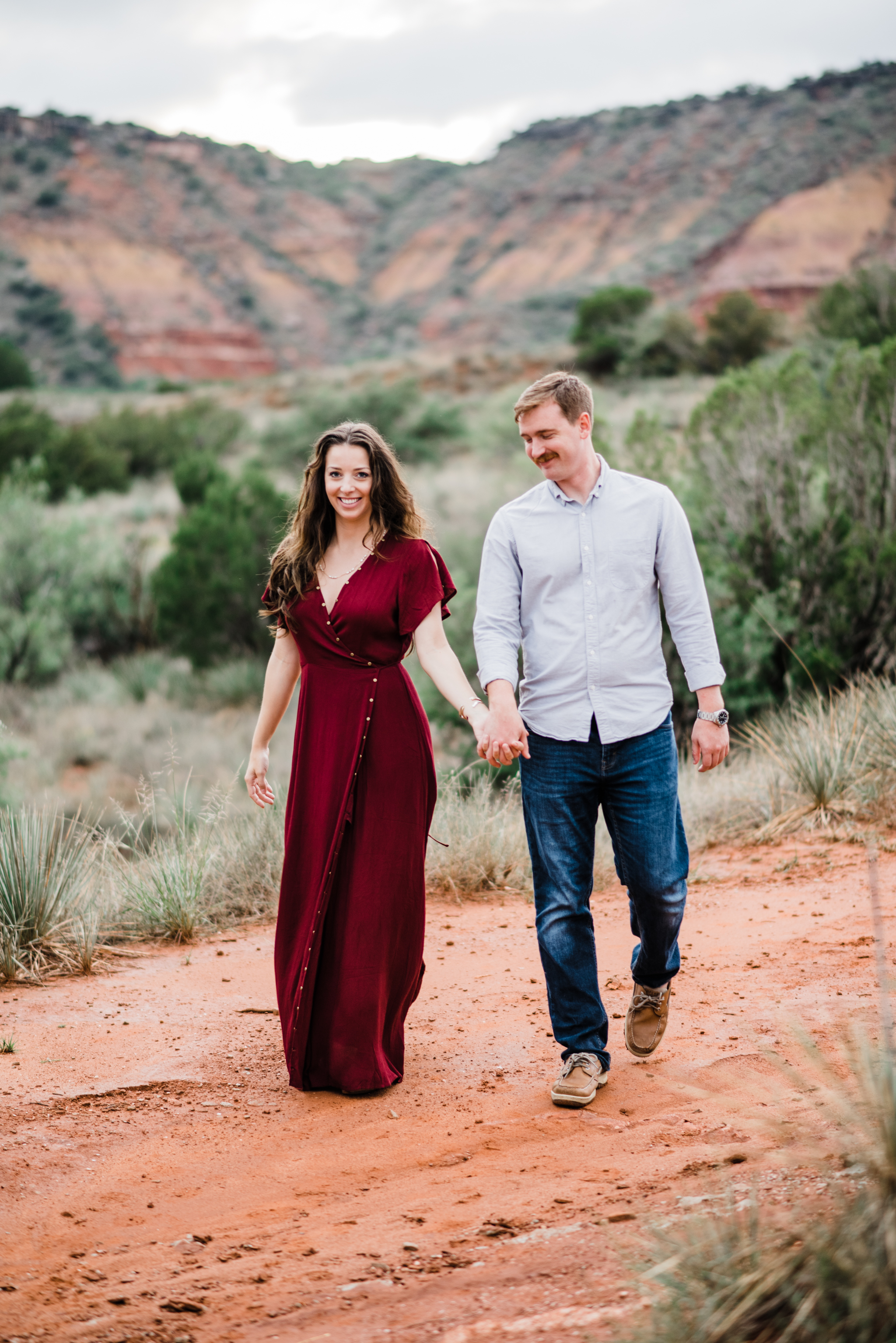 engaged couple hiking down Palo Duro Canyon State Park, Tx