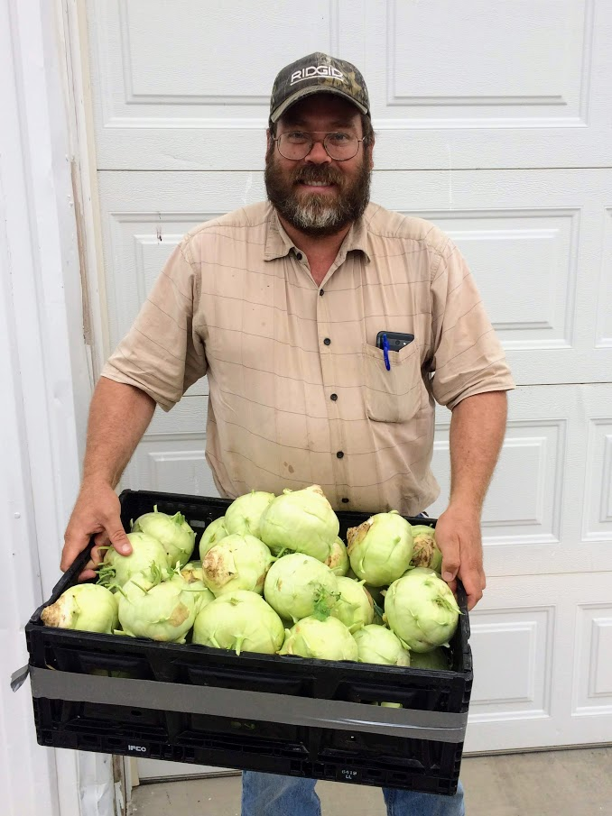 I managed to snap a picture of a few of our producers when they dropped stuff off on Tuesday morning. This is Paul Warner with his killer kohrabis.