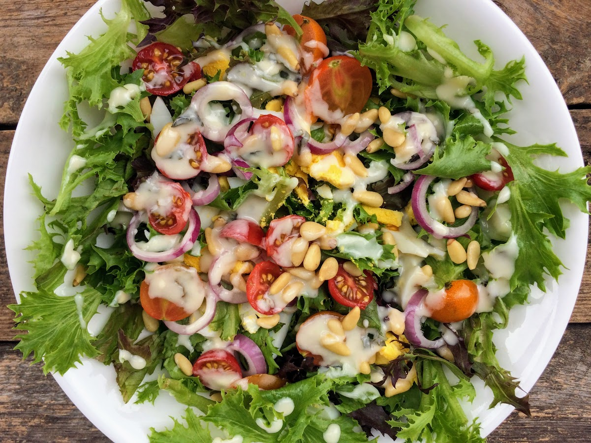 This salad included lettuce, hard boiled eggs, cherry tomatoes, red onions, pine nuts and Olive Garden dressing