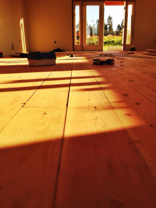 Warm light hitting a wood floor (from our  CSA Farmstand  project)