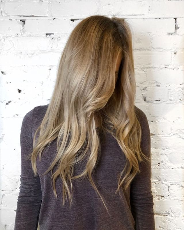 Balayage with root smudge glaze! This is a great technique for a low maintenance blonde look that only requires touching up every few months. Silver shampoo is recommended for low maintenance blondes to keep the cool tones in the hair between visits.  - - - #machorn #CHLhairbyMac #customhairlounge #chicagohairstylist #midwesthairstylist #chicagosalon #chicagohair #lincolnpark #linconlparkhair #lincolnparksalon #balayage #blonde #highlights #bronde #colormelt #hairtrends #wavyhair #blondebalayage #alfaparf #rootmelt #blondehair #chicagostylists #crafthaircolor #modernsalon #balayagehighlights #babylights #ashblonde #longhair #chicagostylist #olaplex