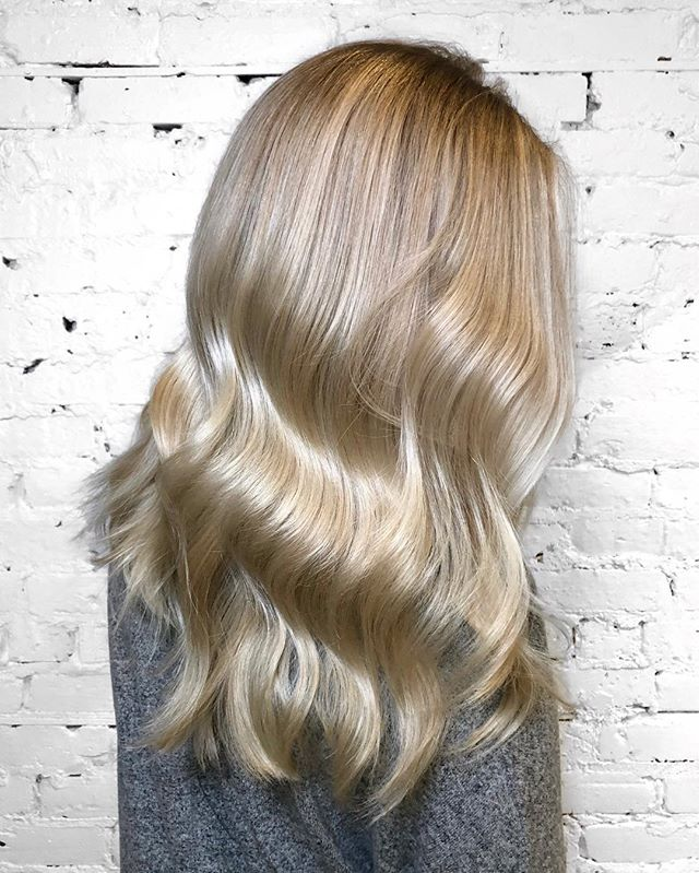 Bright platinum balayage to get ready for spring and summer! This color took several sessions to achieve and there is @olaplex in every step to keep the hair healthy. @refstockholm Cool Silver Shampoo would be a perfect option to keep this shade at home - - - #machorn #CHLhairbyMac #customhairlounge #chicagohairstylist #midwesthairstylist #chicagosalon #chicagohair #lincolnpark #linconlparkhair #lincolnparksalon #balayage #blonde #colormelt #hairtrends #longhair #alfaparf #blondebalayage #blondehair #hairinspo #crafthaircolor #bestofbalayage #beautylaunchpad #platinumblonde #platinumhair #chicagostylist #babylights #longhairdontcare #hairofinstagram #hairpainting #1000orbust
