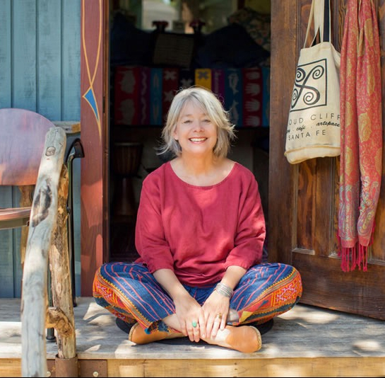 Linda Mason Hunter...at home on the deck of 'The Gypsy Wagon'. Lindas tiny home away from home.