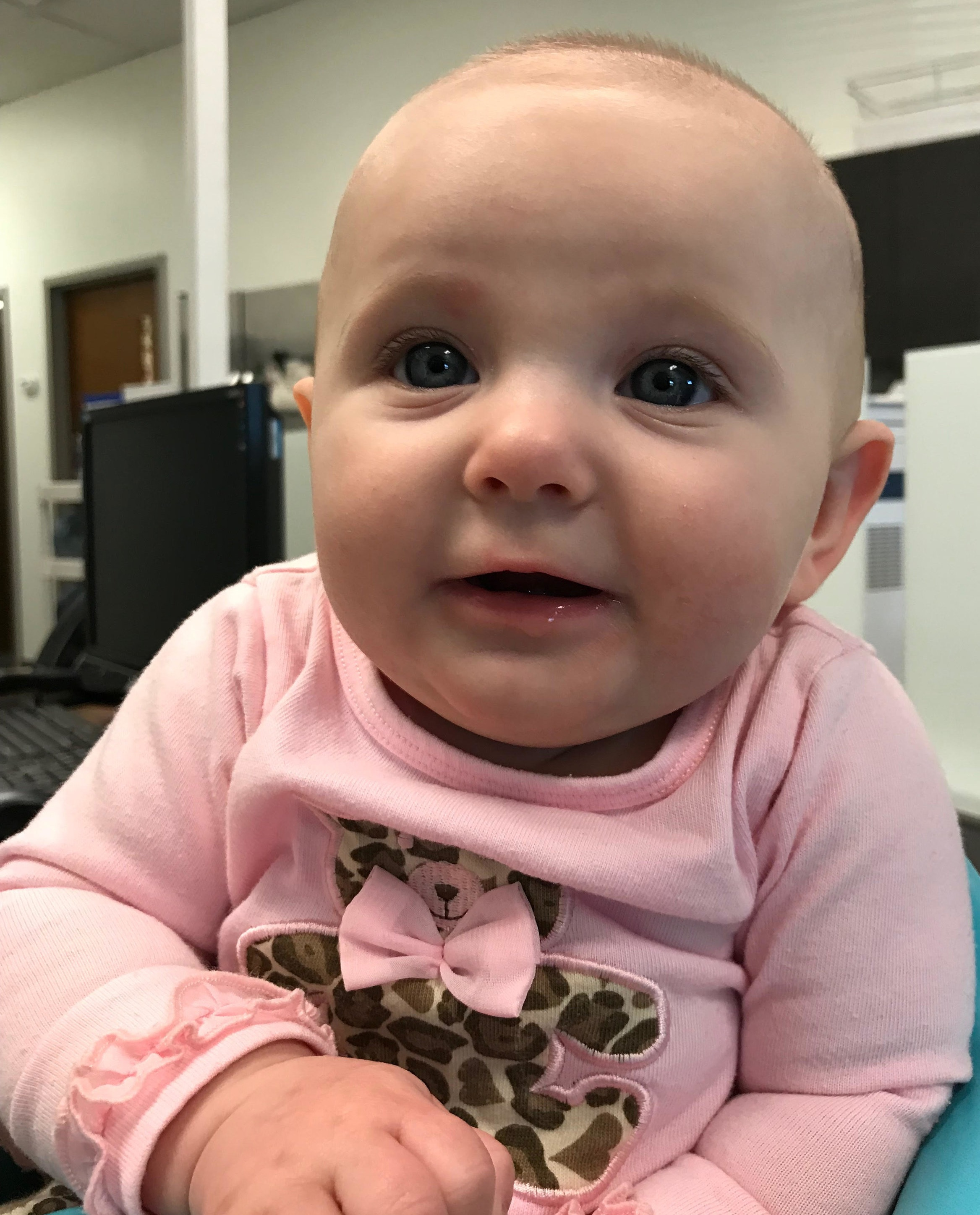 My daughter, the newest office baby, at 4 months old.