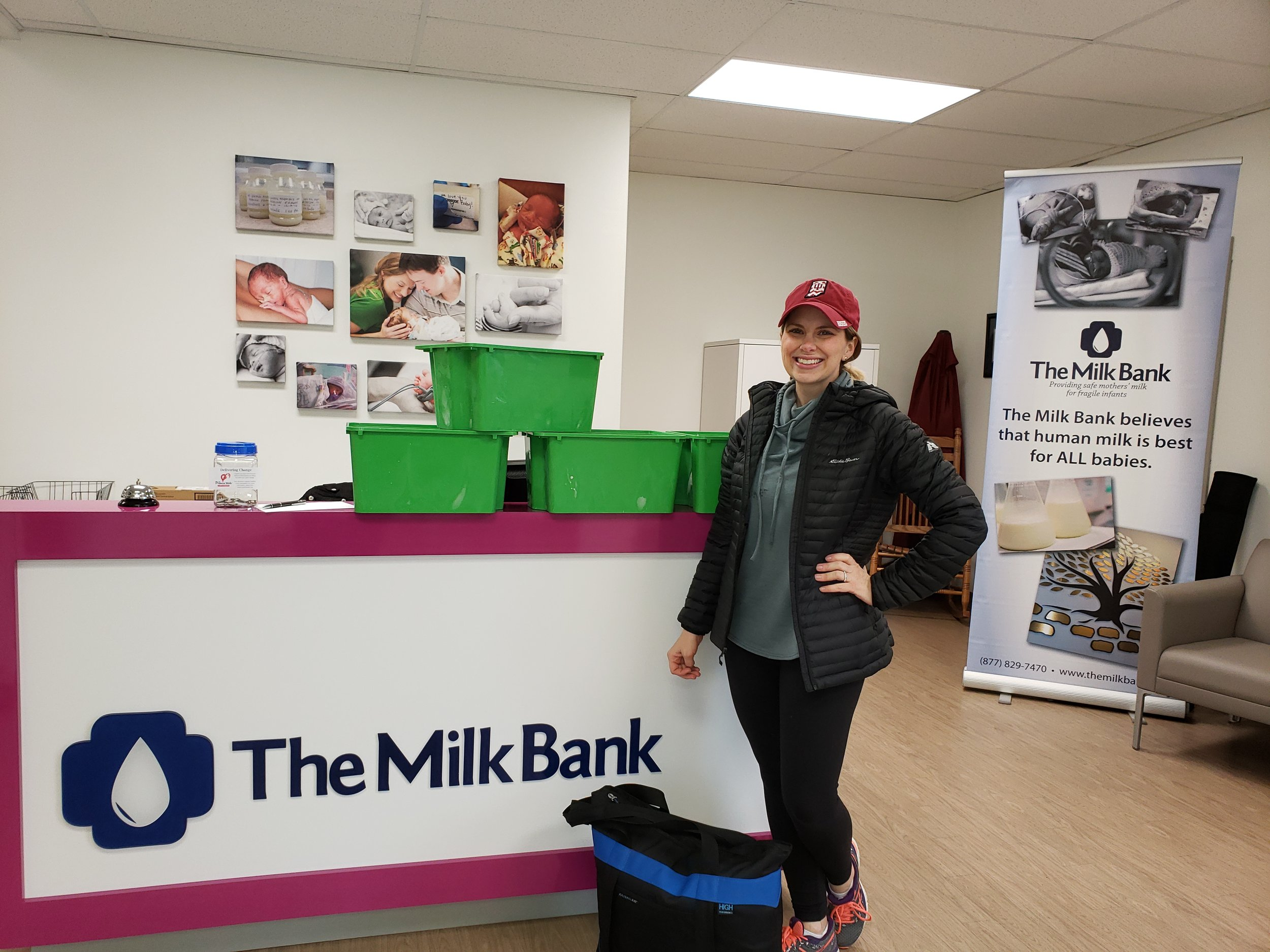 An approved donor drops off a milk donation at the office.