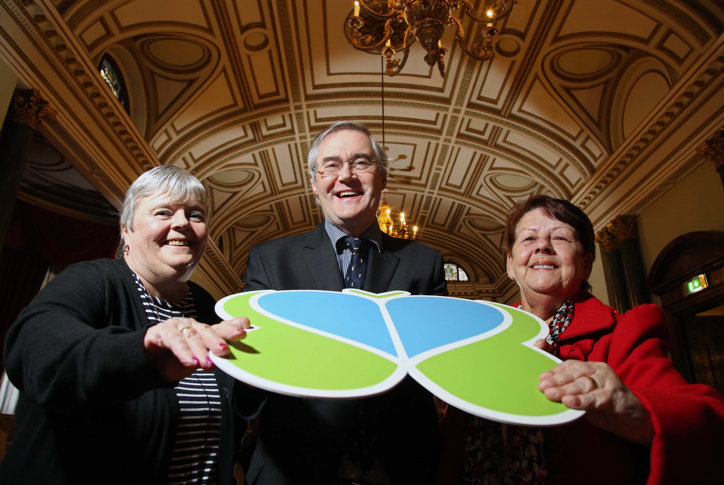 Pictured with Dr Eamon Phoenix are Brain Injury Matters service users Margaret Kinnard and Jean Mc Veigh.