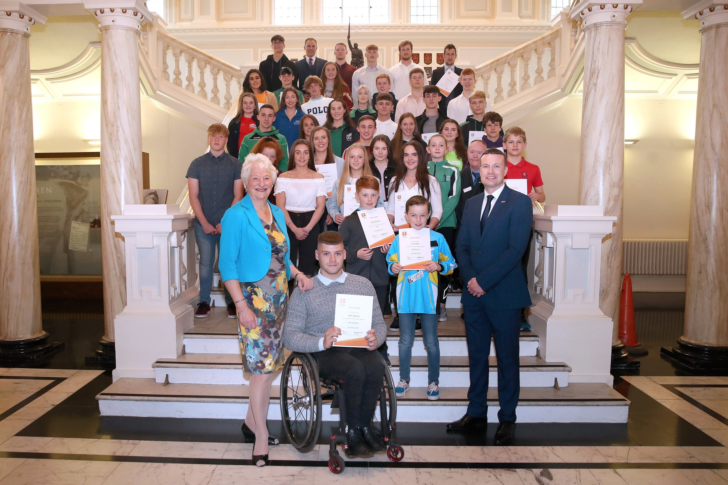 Lady Mary Peters, and GLL Regional Community Sports Manager Ronan McKenna with the GLL Sport Foundation Awards winners at Belfast City Hall last night.