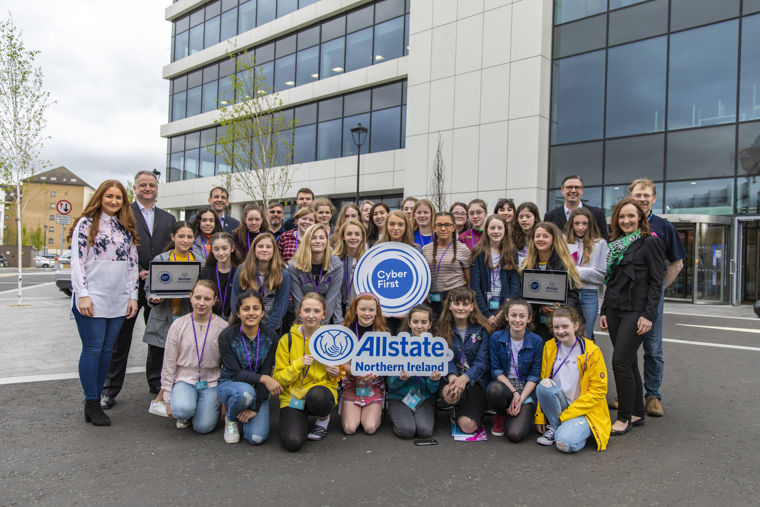 (Second from left):  John Healy, vice president and managing director, Allstate Northern Ireland with the participants of the CyberFirst Girls Defenders course hosted at Allstate's Belfast offices. The CyberFirst Girls Defenders course is a key part of the U.K. government's National Cyber Security Programme. Fifty girls aged 13-14 attended the programme.
