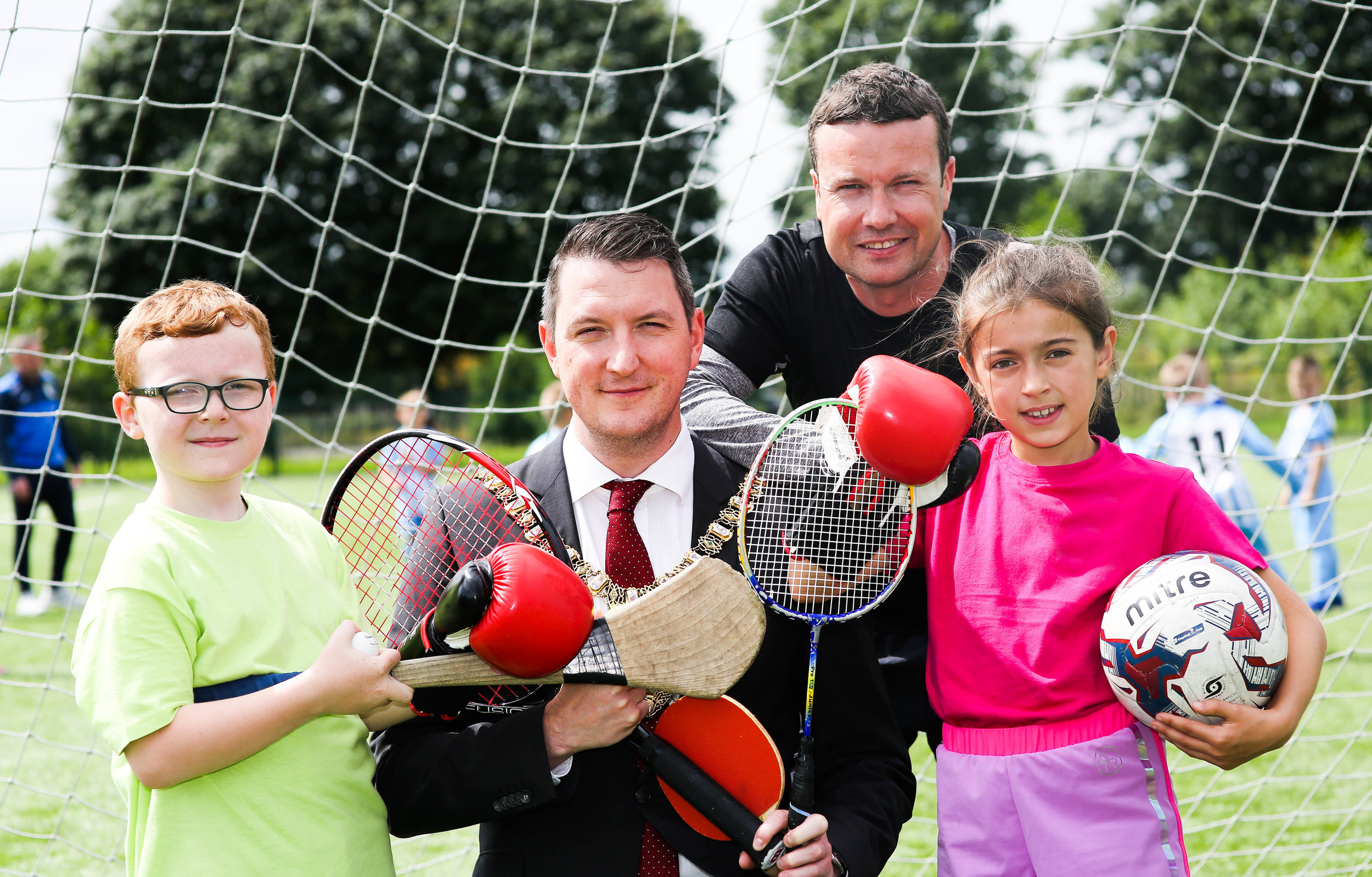 The Lord Mayor of Belfast, John Finucane joins Aidan Thompson from Avoniel Leisure Centre, Leila O'Rawe from Falls Leisure Centre, and Ronan McKenna, GLL Community Sports Manager, at the annual Belfast Summer Sports Day hosted by GLL.