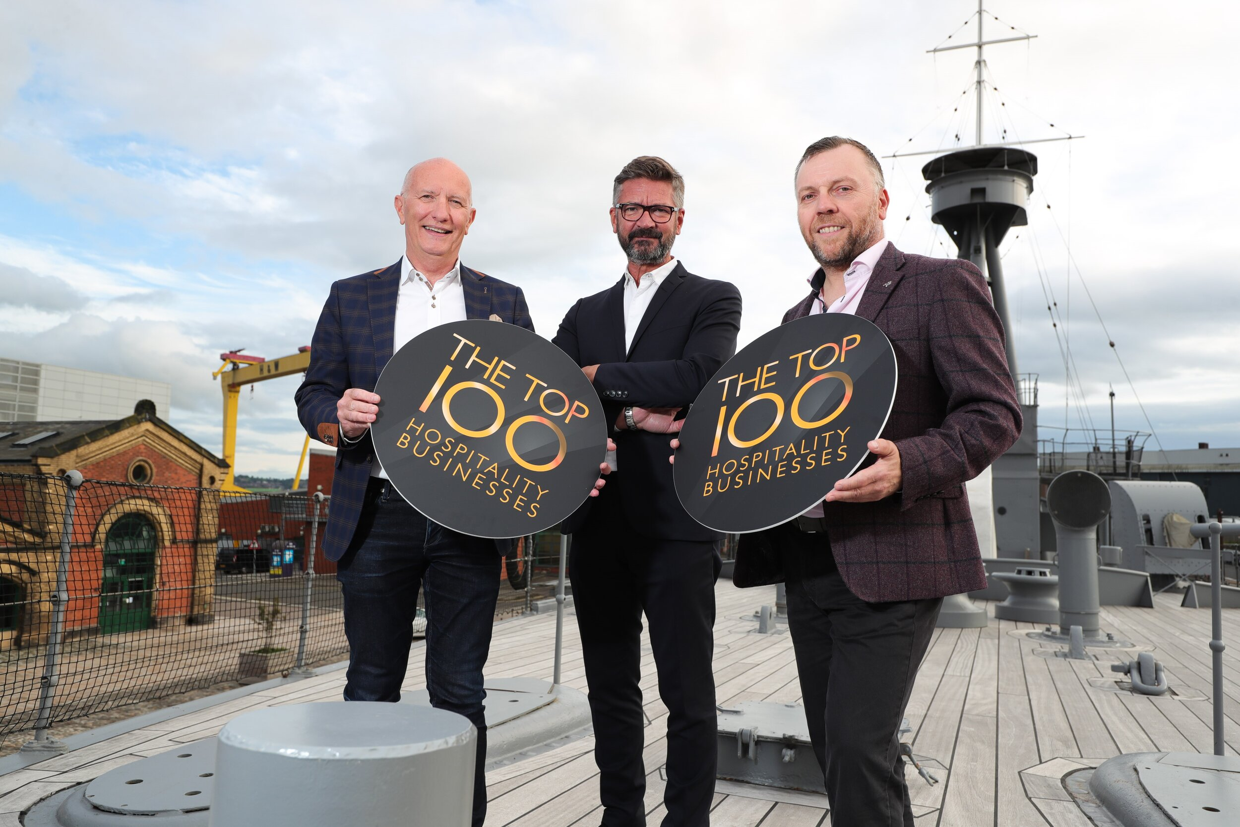 Launching the Top 100 Hospitality Businesses Awards in Northern Ireland for 2020 on HMS Caroline:  Colin Neill, Chief Executive Hospitality Ulster, Joris Minne, Food Critic and Chair of the Top 100 judging panel, Mark Stewart, Hospitality Ulster Chairman.