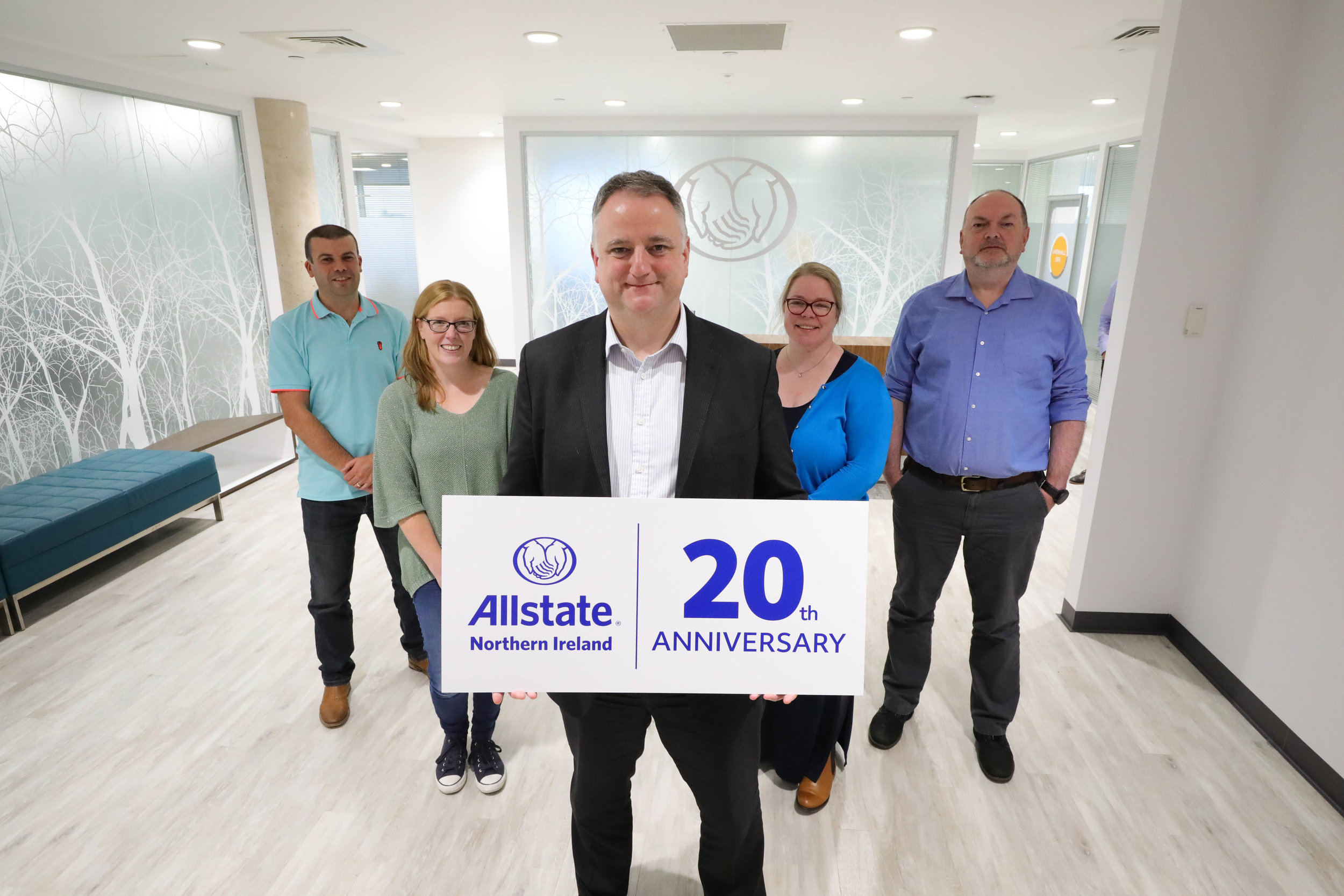 John Healy, Vice President and Managing Director of Allstate Northern Ireland celebrating the 20th anniversary with staff who have twenty years of continuous service. L-R Mark Lilburn, Pauline Lilburn, Jayne Workman, Paddy Warnock with Vice President and Managing Director John Healy centre.