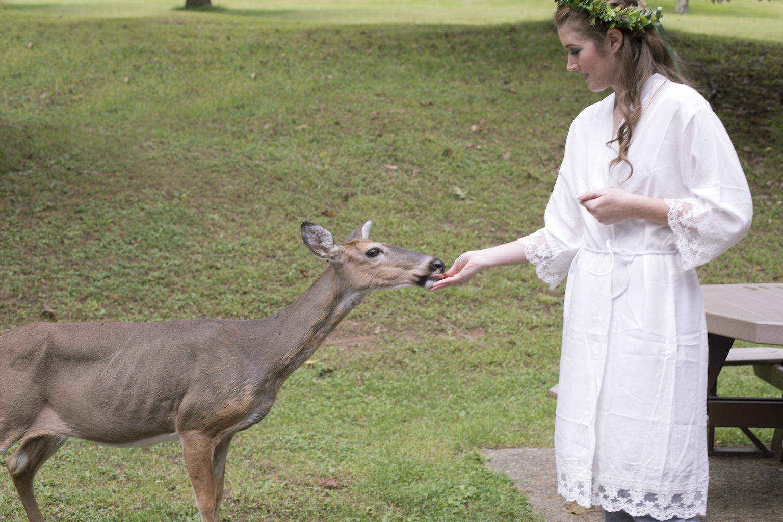 I don't think I'll ever get a Bride hand feeding a deer again. It was so magical and fit with the day so well. This resort is home to A LOT of deer that are extremely friendly as you can see.