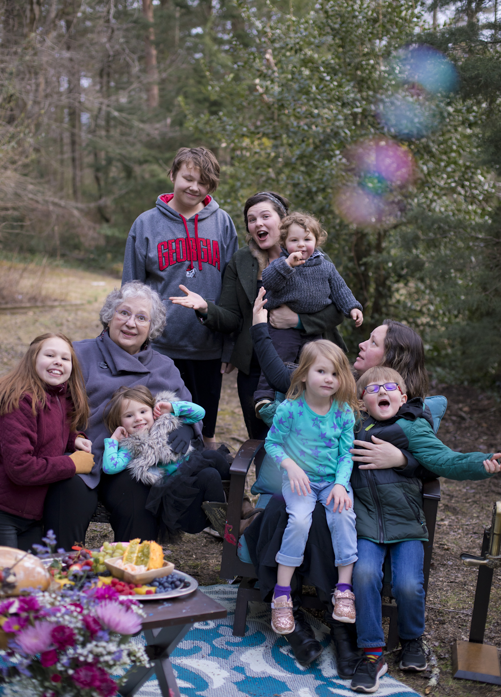 How do you keep everyone's attention throughout a family group photo? BUBBLES! Although sometimes the adults are more crazy about them than the kids :)