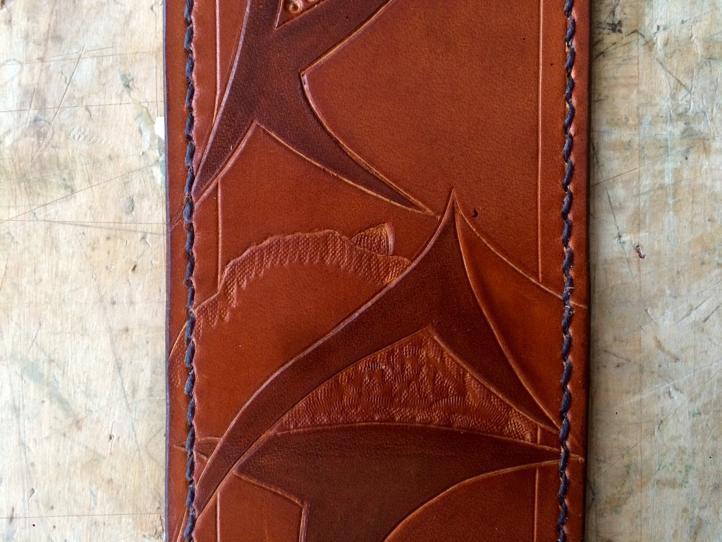Saddle-stitch shown on custom guitar strap