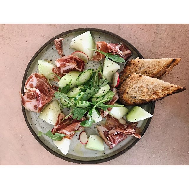 First things first - today's special : desayuno de campeones feat. piel de sapo melones, coppa, @jennasmuller's amazing polenta bread, serpent cucumbers and spicy arugula from @openfieldfarm 🤤🤤🤤 SEGUNDO: Hugo Street is having a BLOCK PARTY and we'll be firing up the grill to make CHORIPANES aka Vennie HotDawgs so come grab one starting 2pm #wholetthedogsout