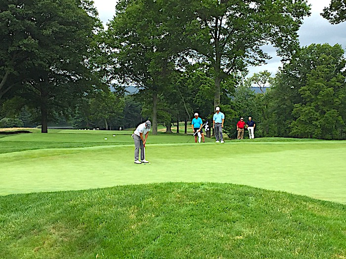 John VanDerLaan holes out a five-foot putt on No. 15 at New Haven CC for a birdie that gave him a one-shot lead, which he held on to win the Connecticut Open.