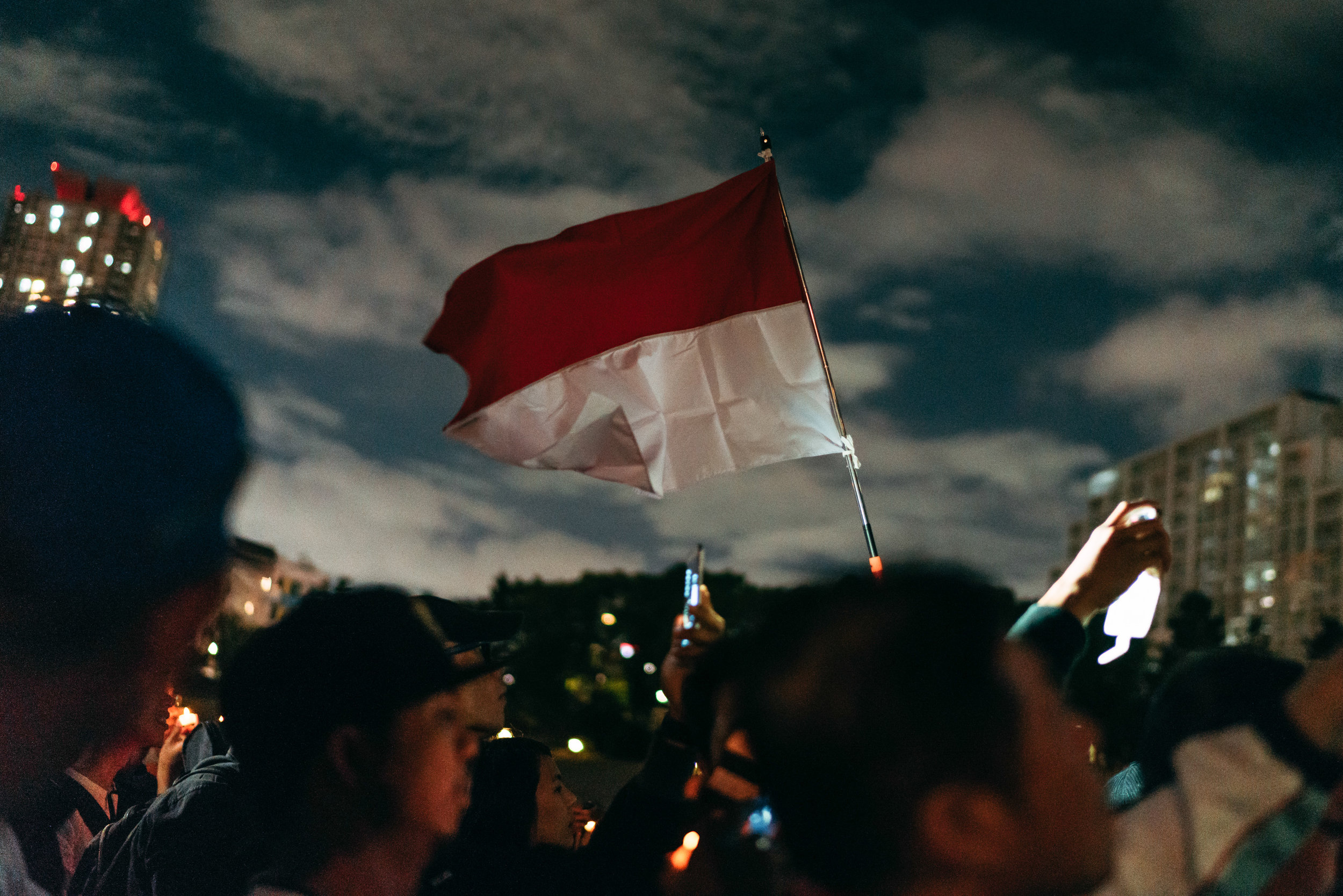 Indonesian flag flown as a chorus of the national anthem 'Indonesia Raya', and with renowned Indonesian musician Maylaffayza